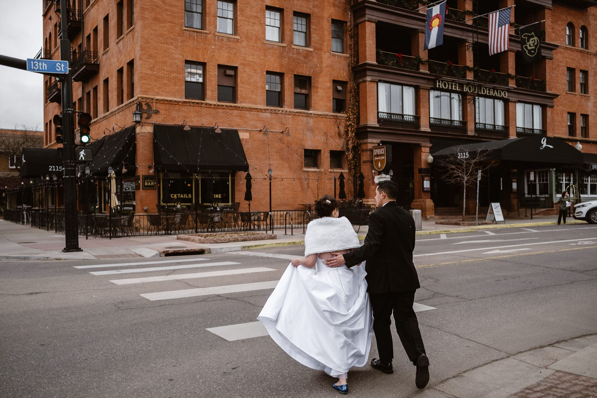 Rembrandt Yard wedding photographer, Boulder wedding photographer, Colorado Jewish wedding, bride and groom crossing street outside Hotel Boulderado