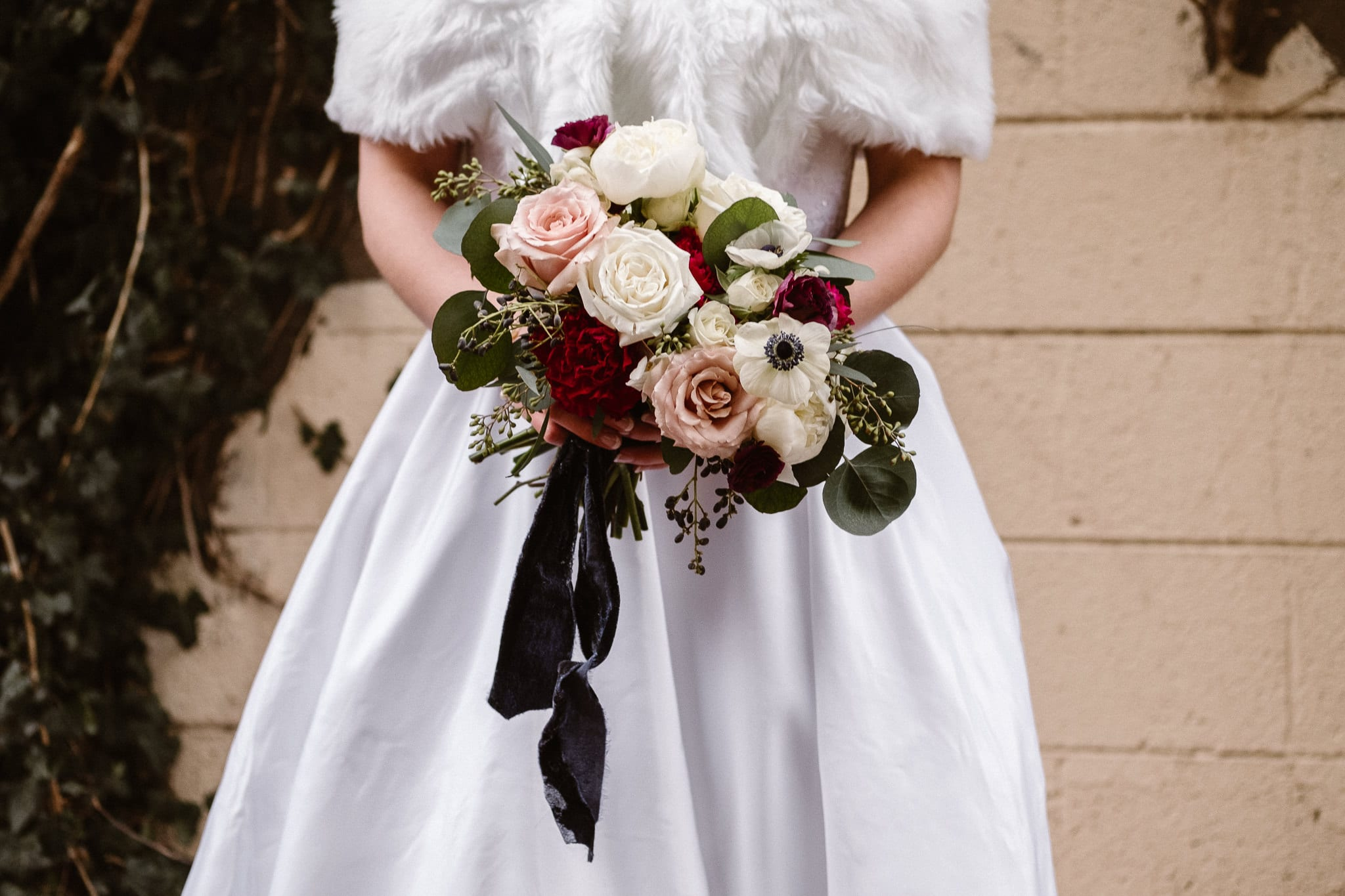 Rembrandt Yard wedding photographer, Boulder wedding photographer, Colorado Jewish wedding, bride and groom portraits in downtown Boulder, bridal bouquet with roses in muted colors