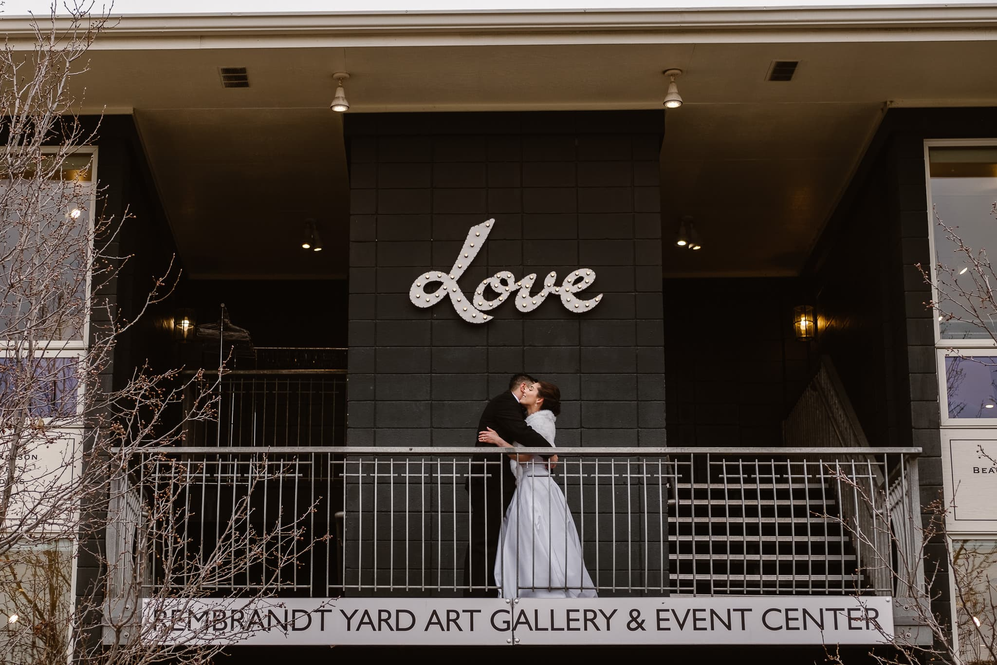 Rembrandt Yard wedding photographer, Boulder wedding photographer, Colorado Jewish wedding, bride and groom portraits in downtown Boulder under Love sign