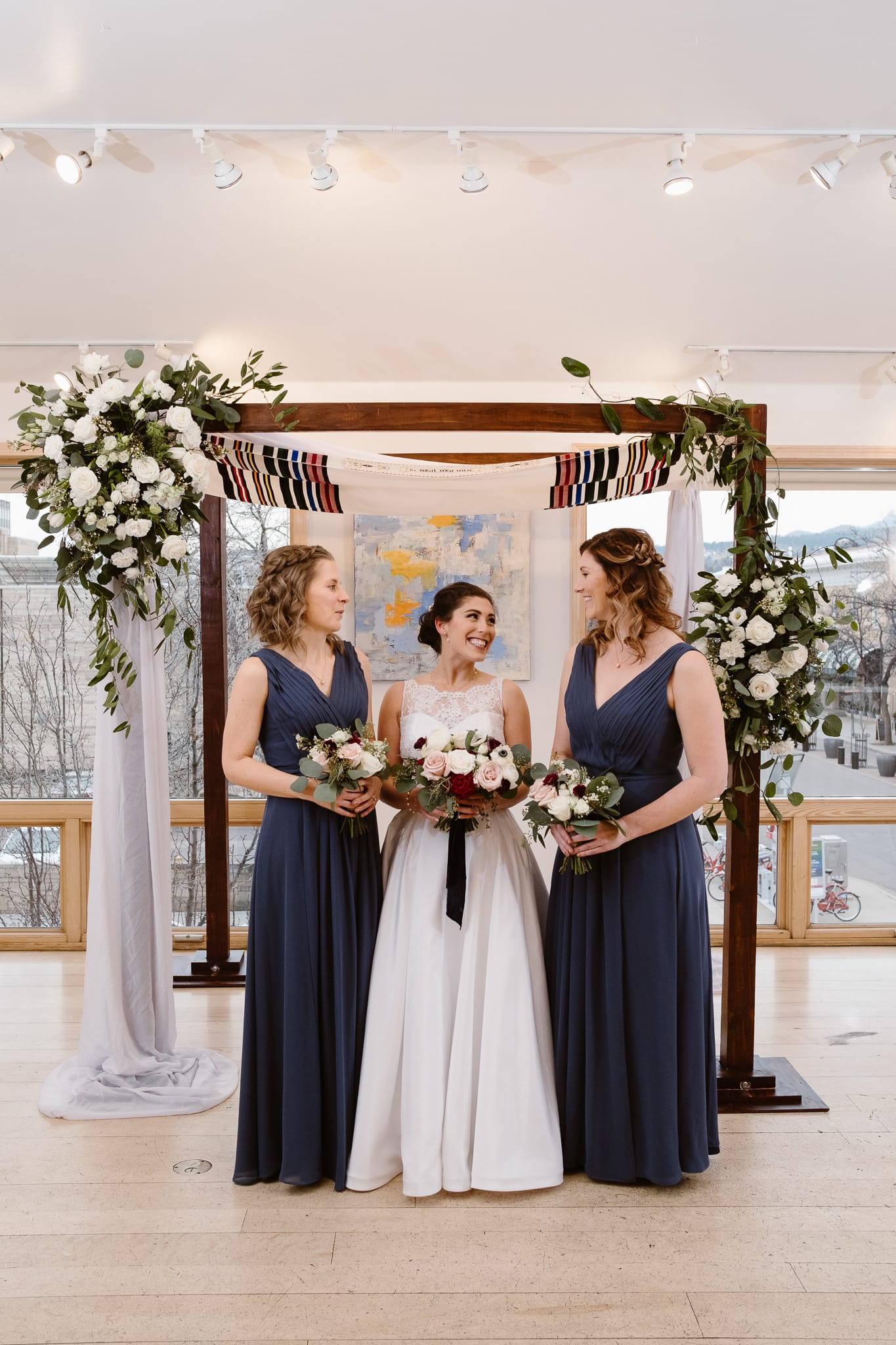 Rembrandt Yard wedding photographer, Boulder wedding photographer, Colorado Jewish wedding, bride with bridesmaids in dark blue dresses