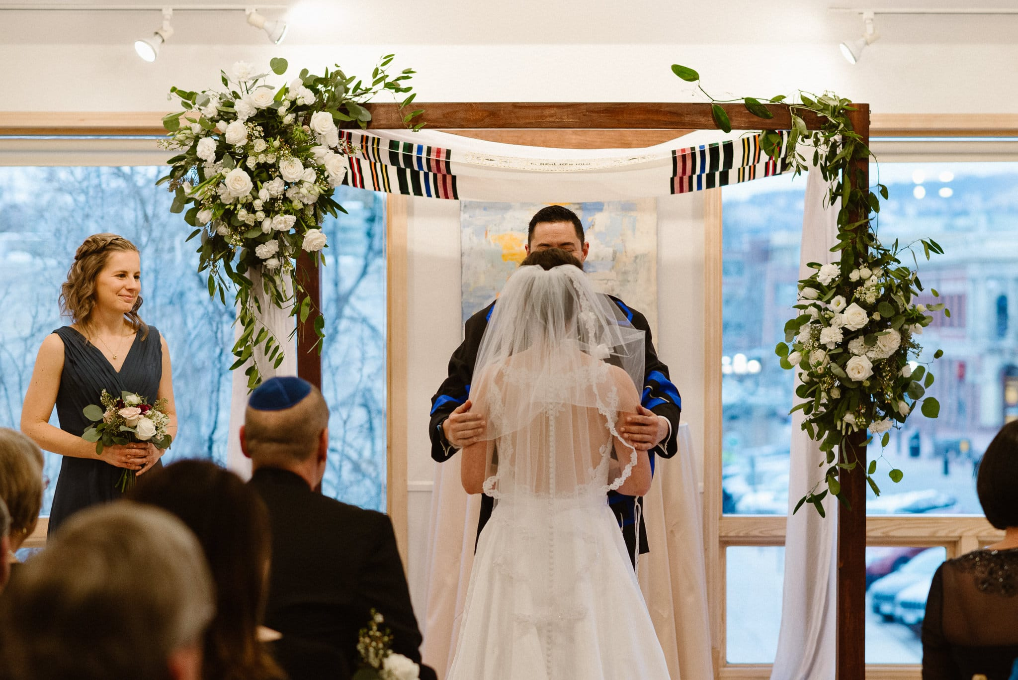Rembrandt Yard wedding photographer, Boulder wedding photographer, Colorado Jewish wedding, groom lifting bride's veil