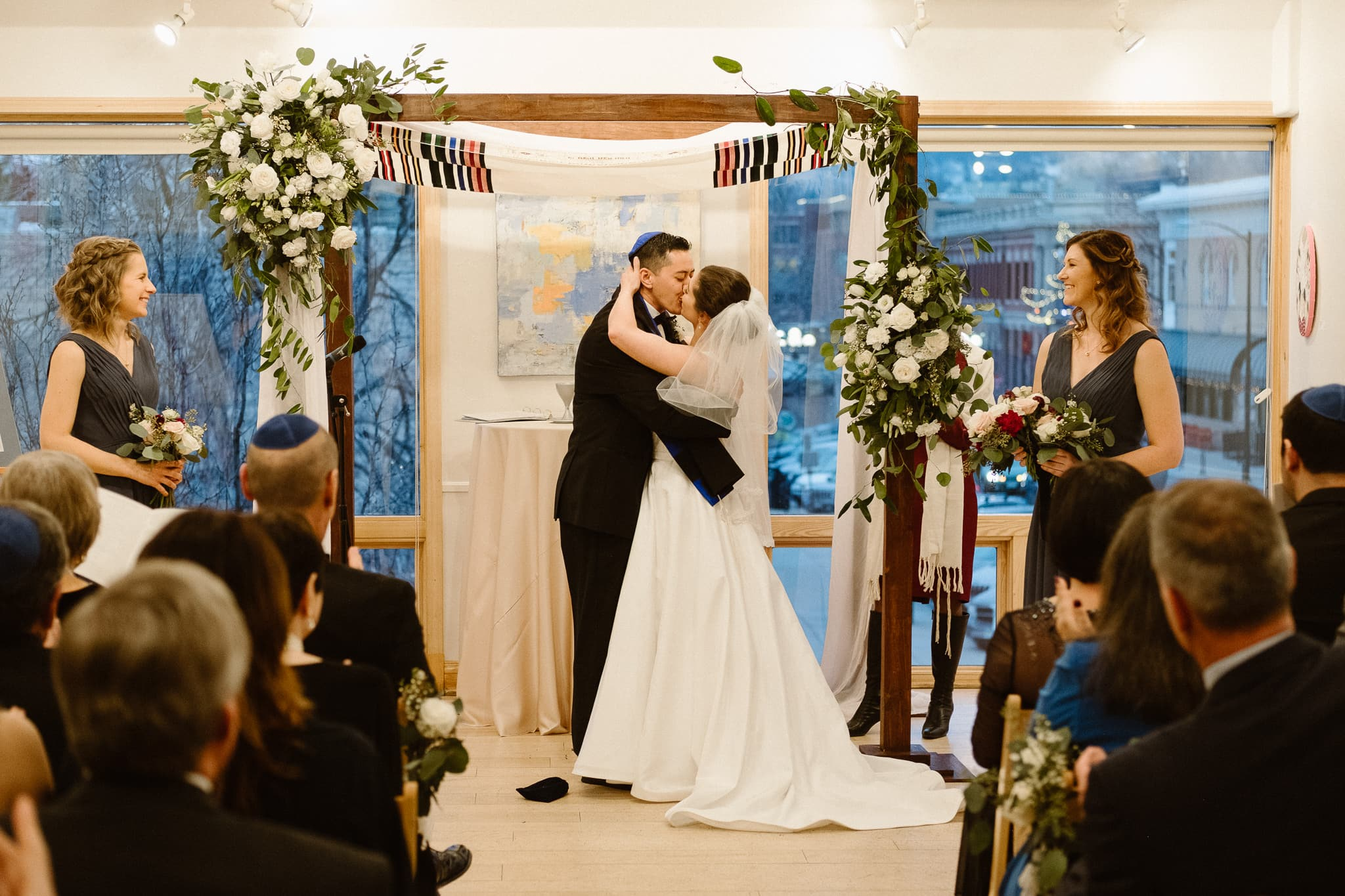 Rembrandt Yard wedding photographer, Boulder wedding photographer, Colorado Jewish wedding ceremony, bride and groom first kiss