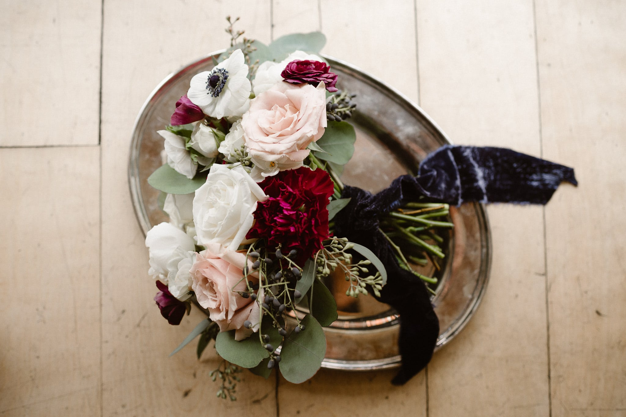 Rembrandt Yard wedding photographer, Boulder wedding photographer, Colorado Jewish wedding, classic wedding bouquet with white pink and red roses and crushed velvet ribbon