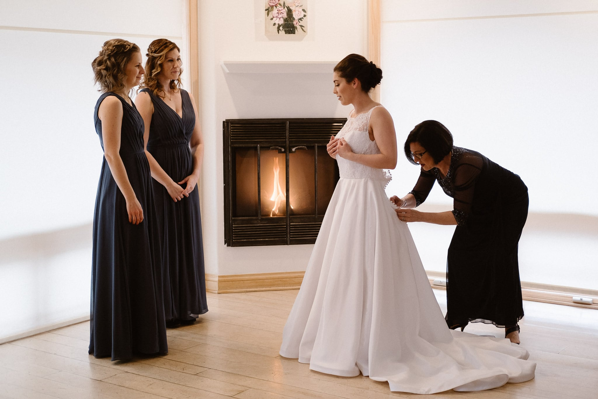 Rembrandt Yard wedding photographer, Boulder wedding photographer, Colorado Jewish wedding, bride and bridesmaids getting ready in front of fireplace