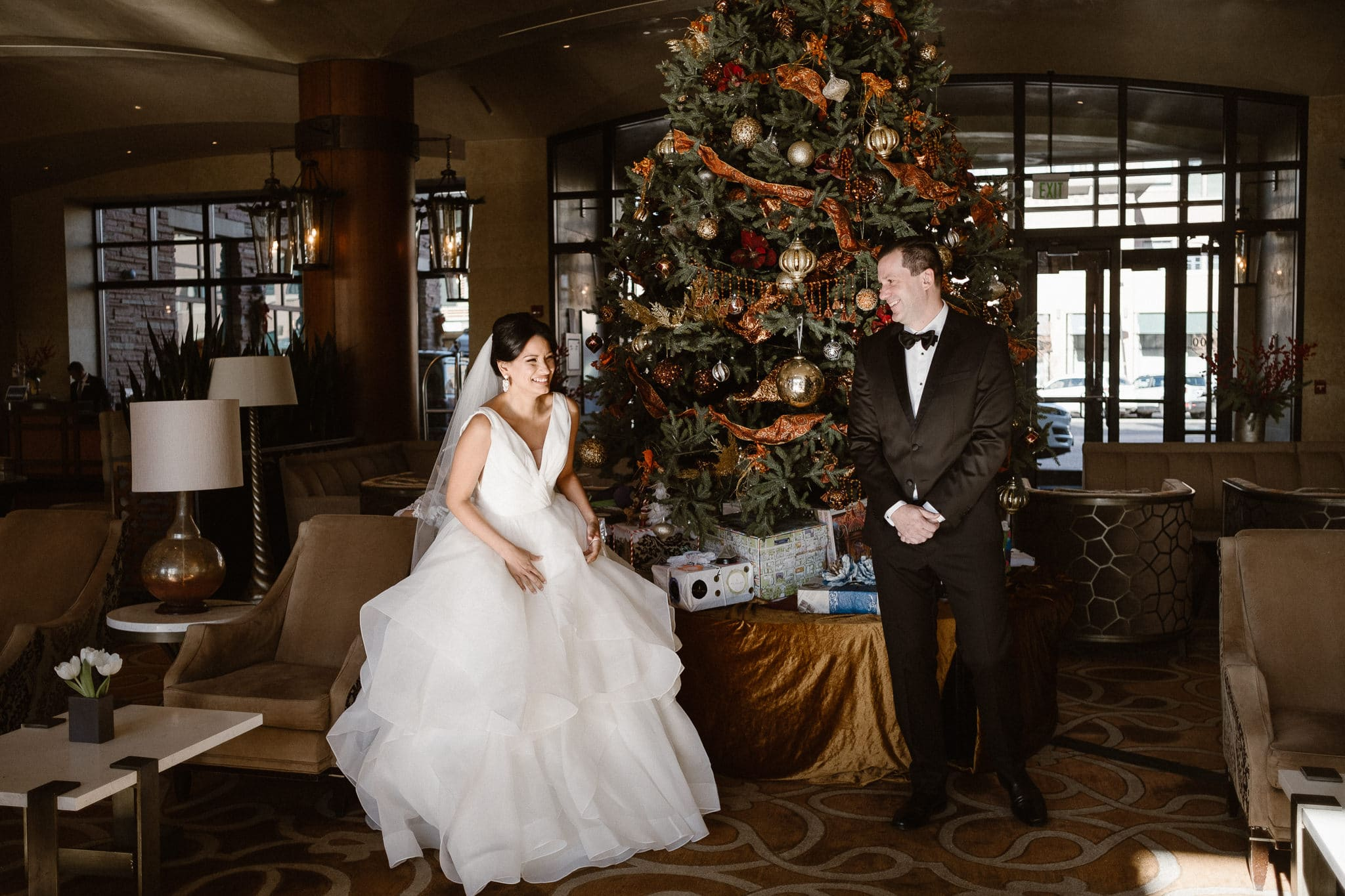 Bride and groom first look in front of giant Christmas tree at The St Julien Hotel & Spa in Boulder, St Julien wedding photographer