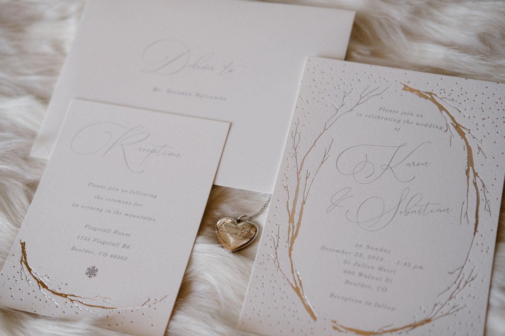 Elegant white and silver wedding invitations and jewelry on fur