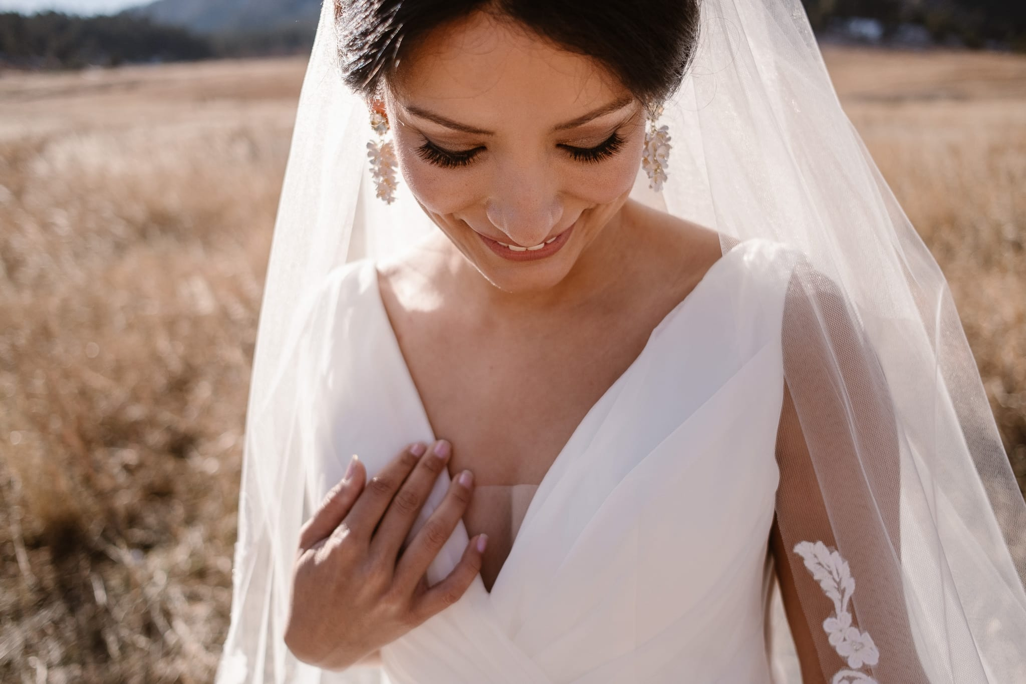 Bride portraits at Chautauqua with views of the Flatirons, Boulder wedding photographer, Colorado wedding photographer, St Julien wedding with mountain wedding photos, bride makeup closeup