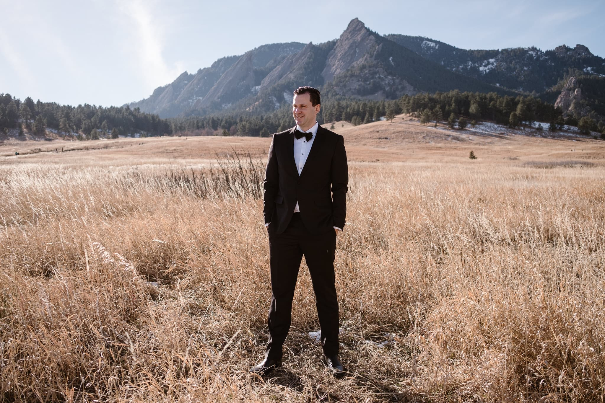 Groom portraits at Chautauqua with views of the Flatirons, Boulder wedding photographer, Colorado wedding photographer, St Julien wedding with mountain wedding photos, groom wearing black suit and bowtie