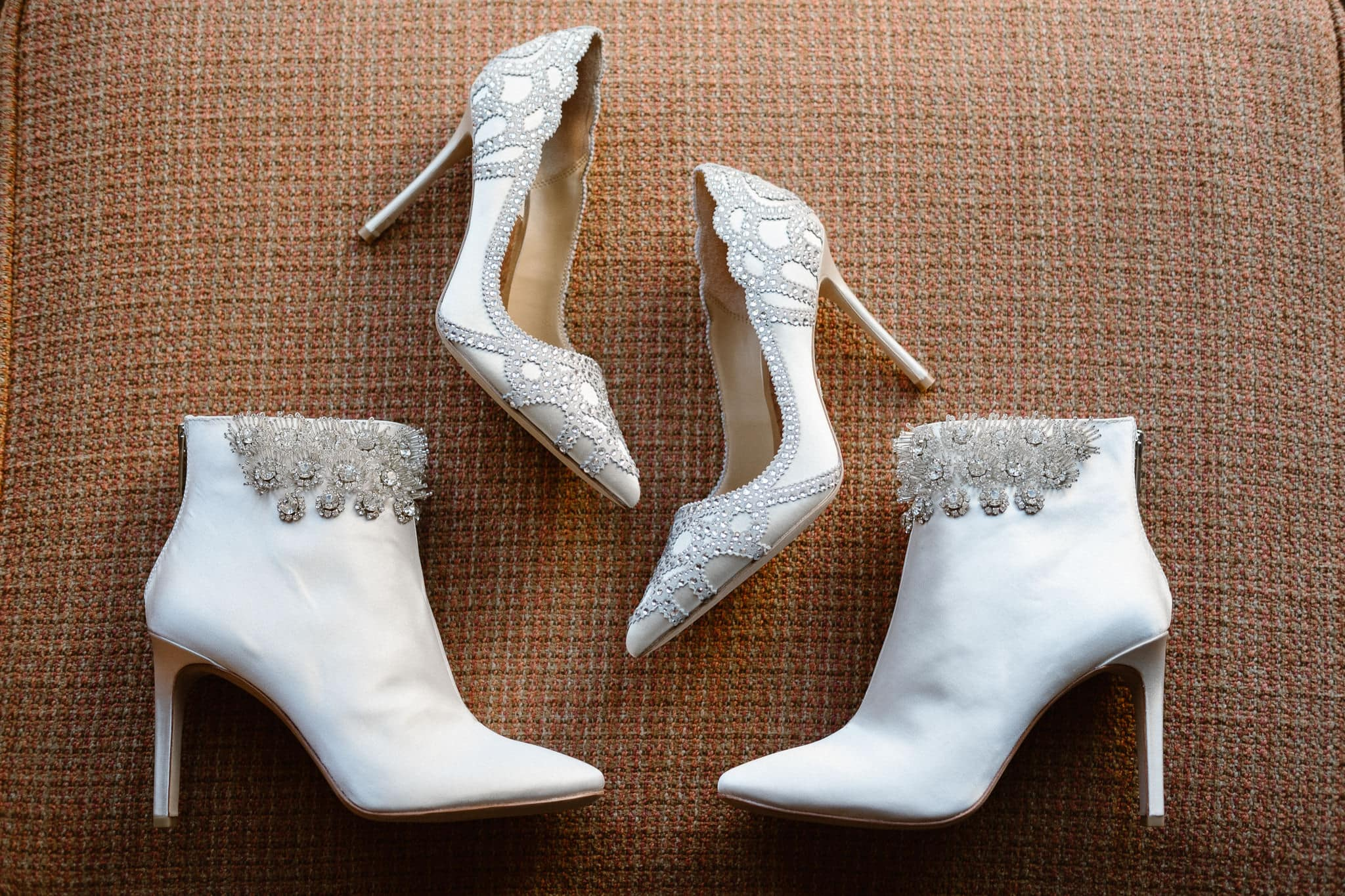 White bejeweled ankle boots and high heels bridal shoes