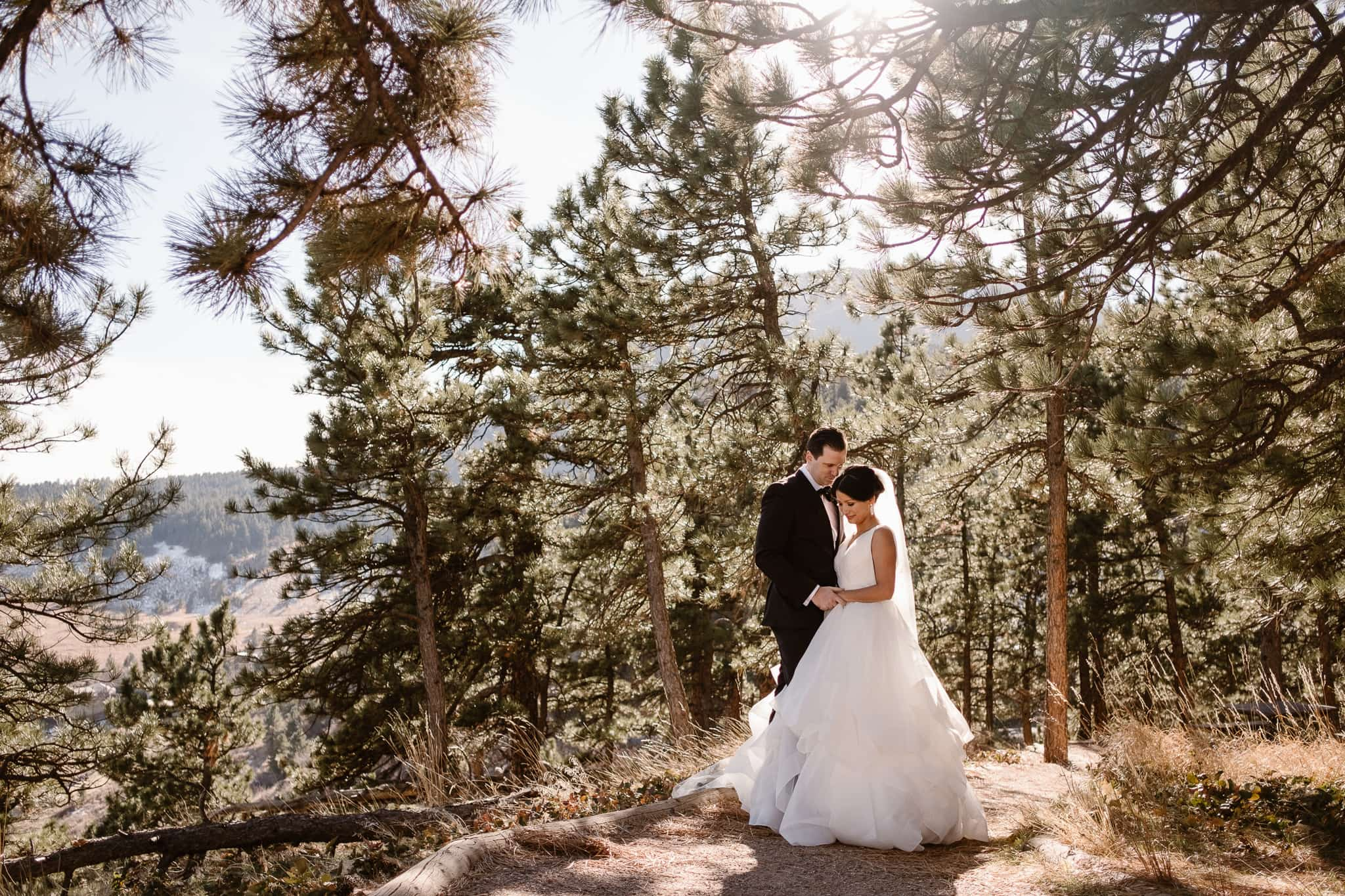 Bride and groom portrait in the woods at Sunrise Amphitheater wedding ceremony venue in Boulder