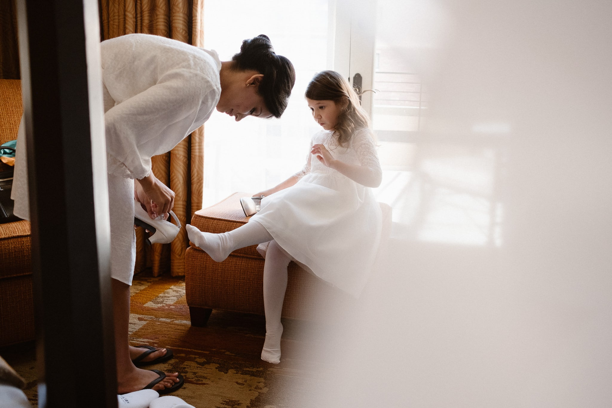 Bride and her daughter getting ready for a St Julien wedding in Boulder, Colorado wedding photographer