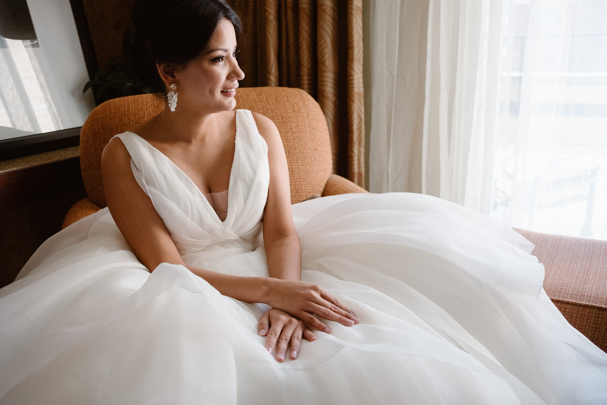Bride sitting in poofy wedding dress