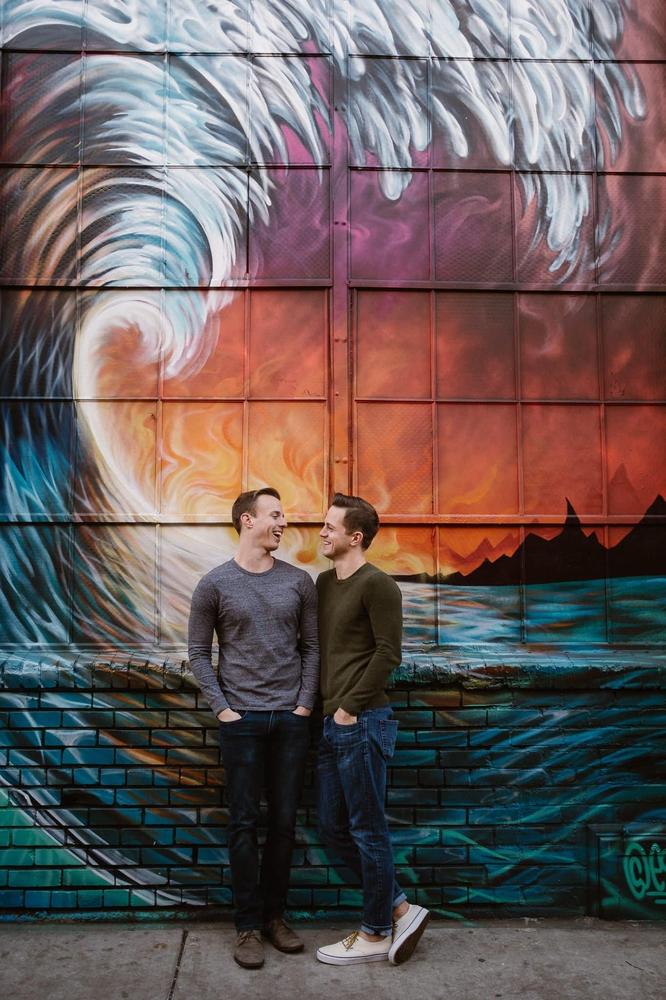 Gay couple in front of street art in RiNo neighborhood of Denver, gay engagement session, Colorado LGBT wedding photographer