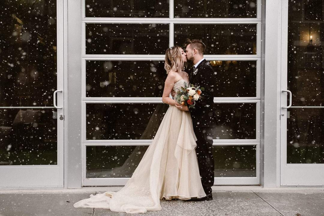 Bride and groom in snow at The St Vrain in Longmont, Colorado
