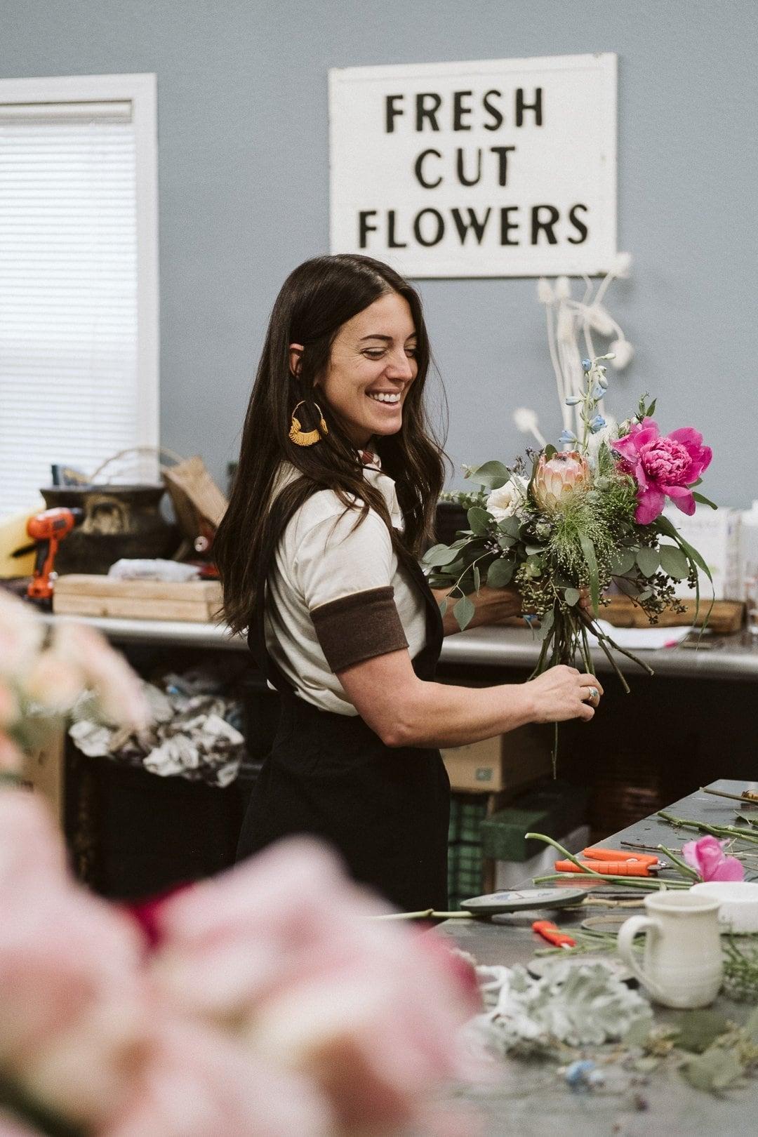 A florae wedding florist making an elopement bouquet