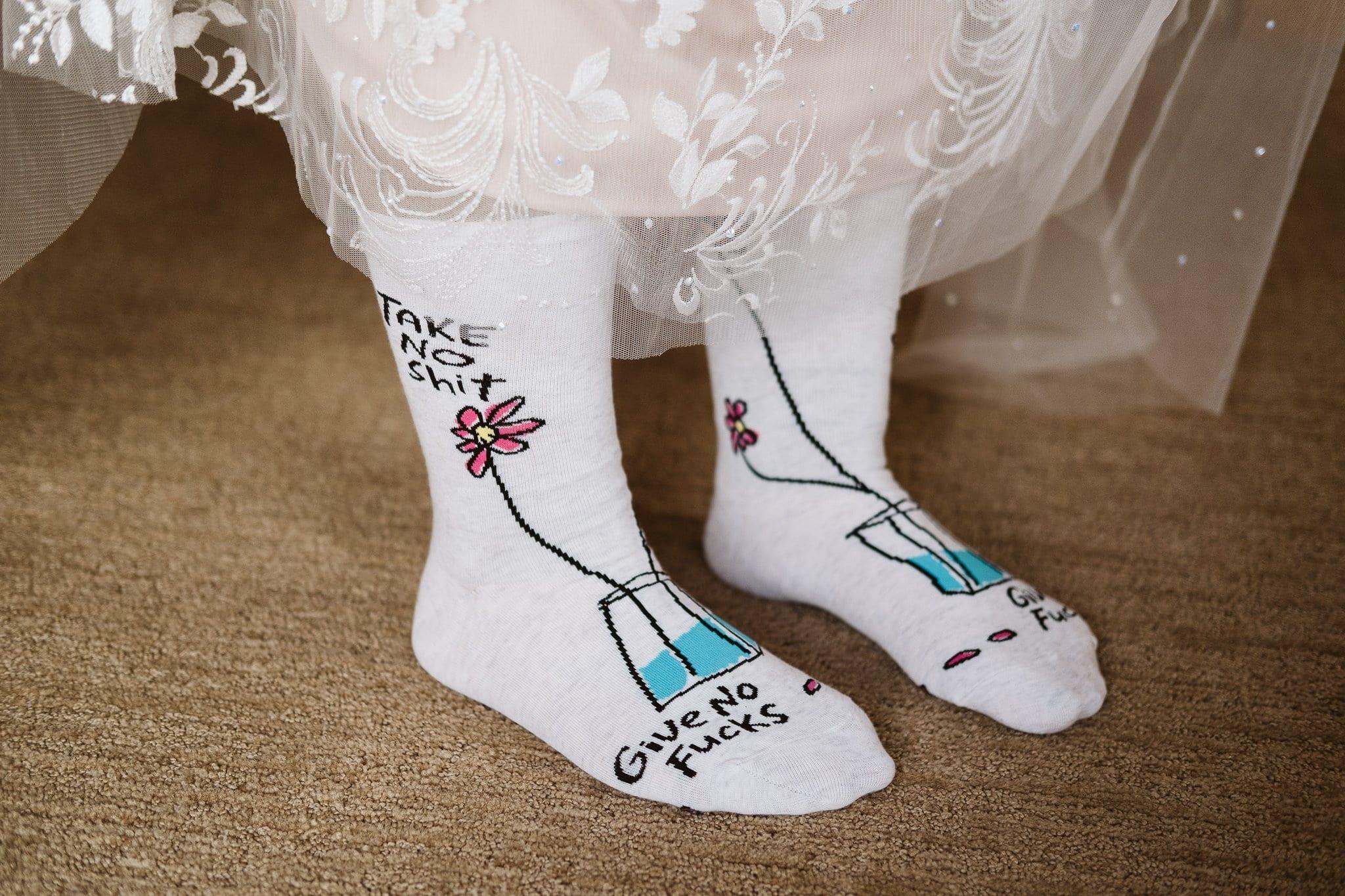 "Bride's wedding socks that say ""take no shit, give no fucks"""