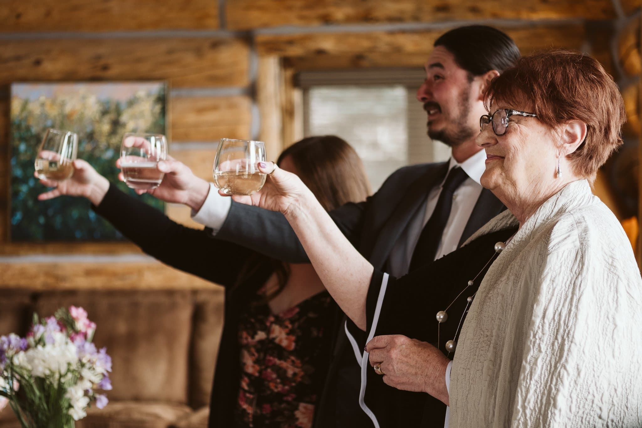 Wedding guests give toast to the bride and groom