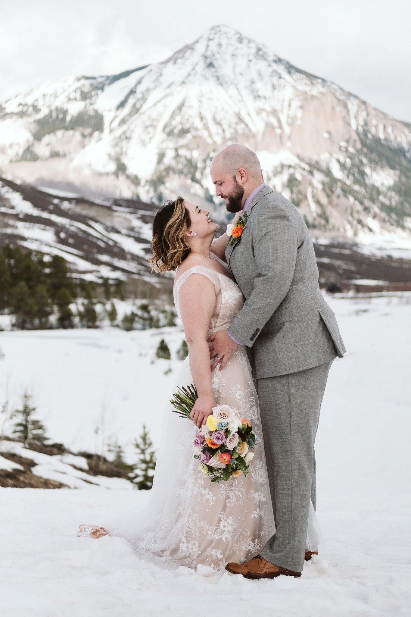 Bride and groom portraits at winter elopement in Crested Butte, snow-covered mountain wedding photos