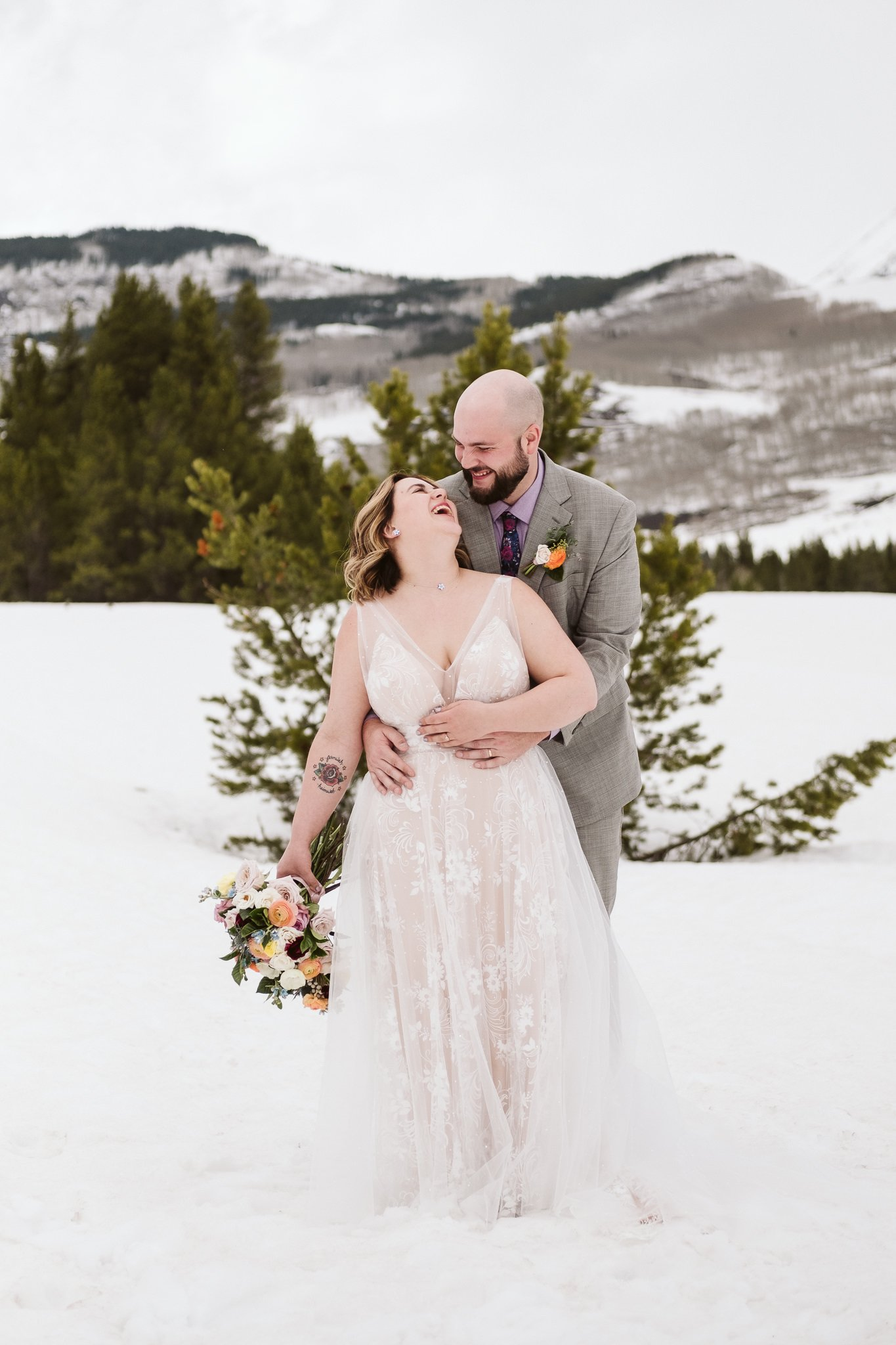Bride and groom portrait in snowy woods, Crested Butte winter wedding photography