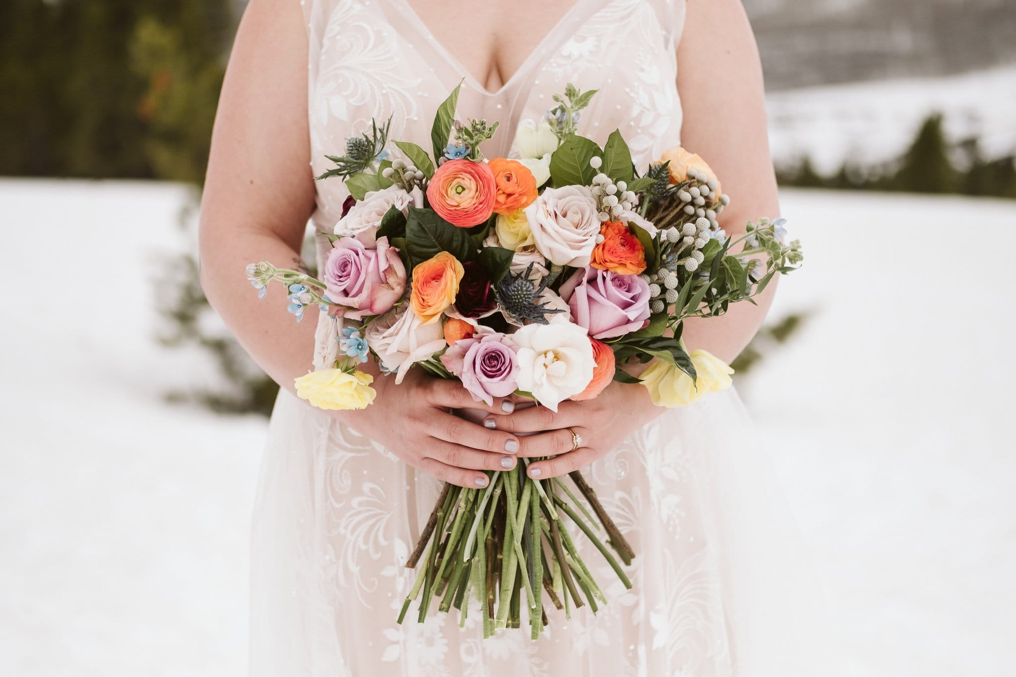 Spring colored wedding bouquet by From the Ground Up Flowers in Crested Butte