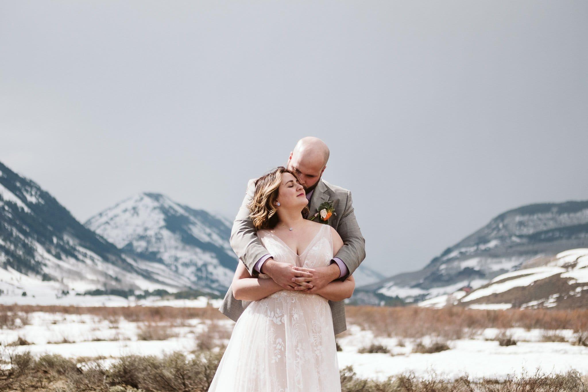 Crested Butte wedding photos in snow, winter mountain elopement, bride wearing blush wedding gown