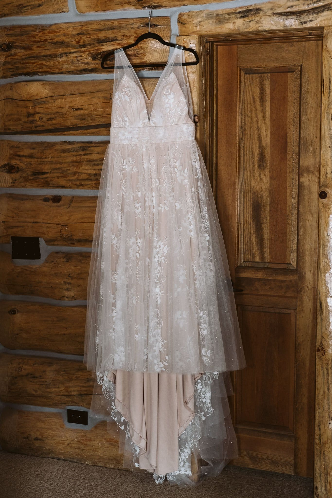Blush wedding gown with tulle and lace layers