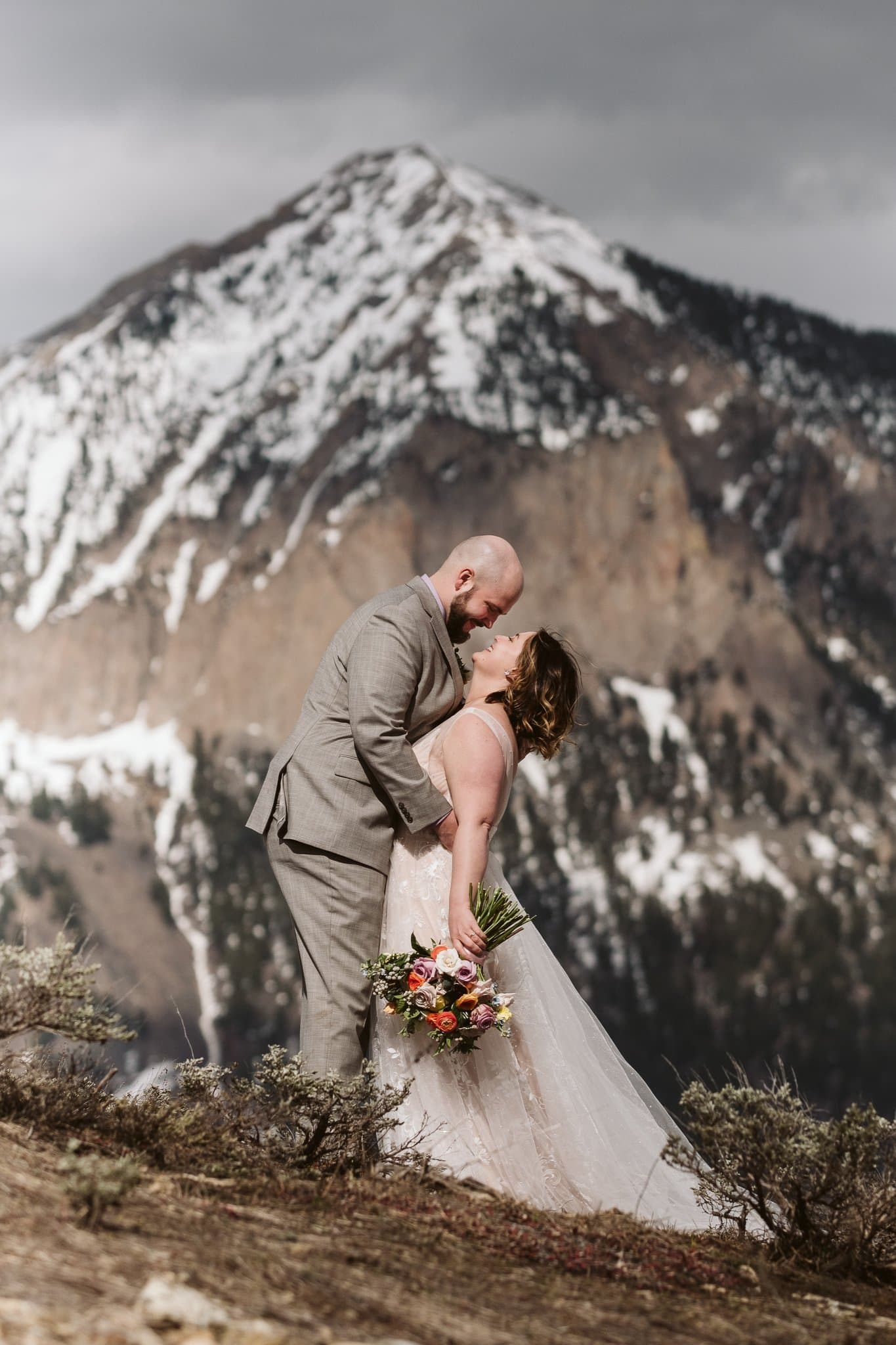 Bride and groom portrait in front of Mount Crested Butte, winter elopement photography, Colorado mountain wedding