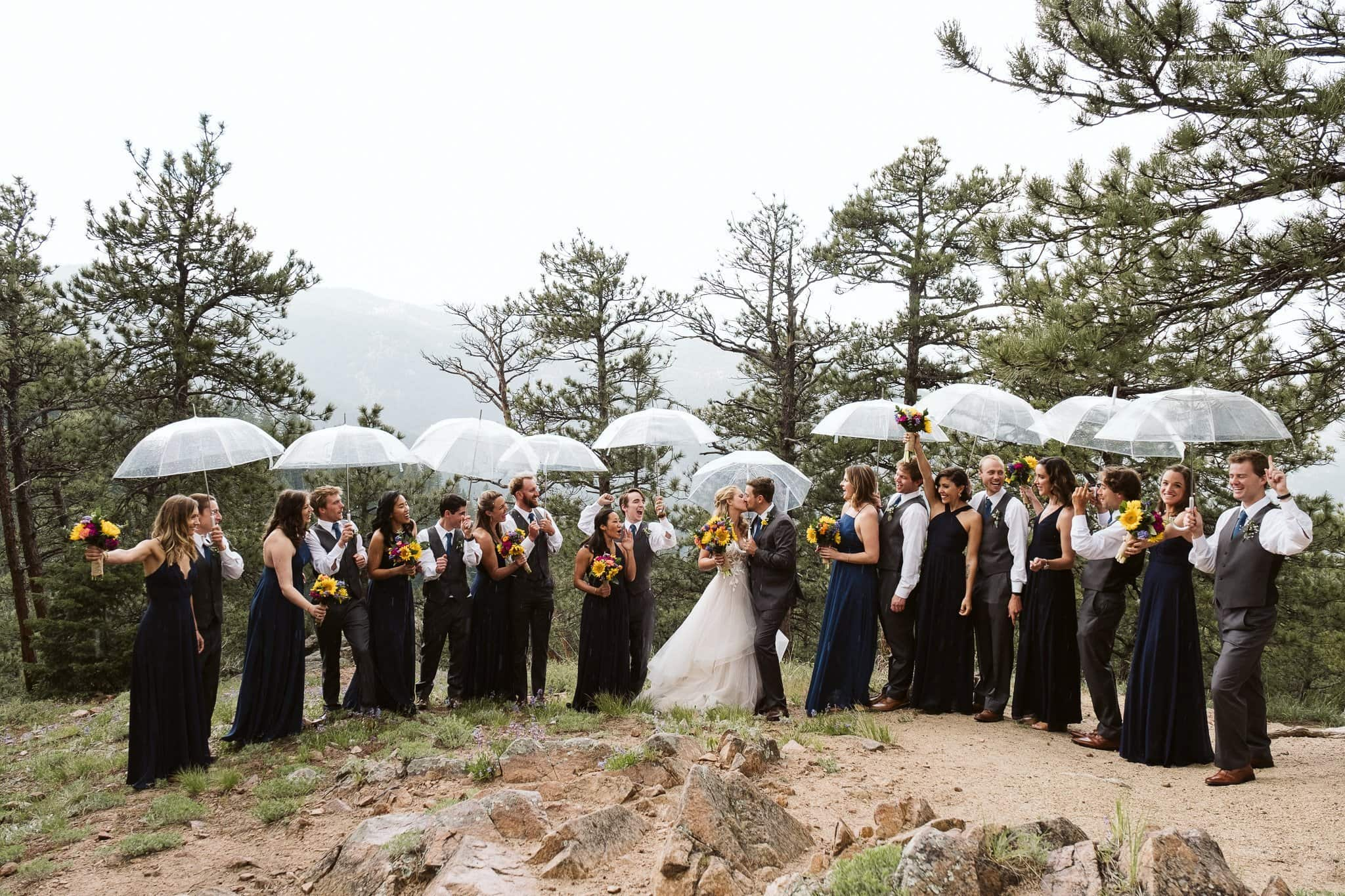 Wedding party photos in the rain after Sunrise Amphitheater ceremony in Boulder