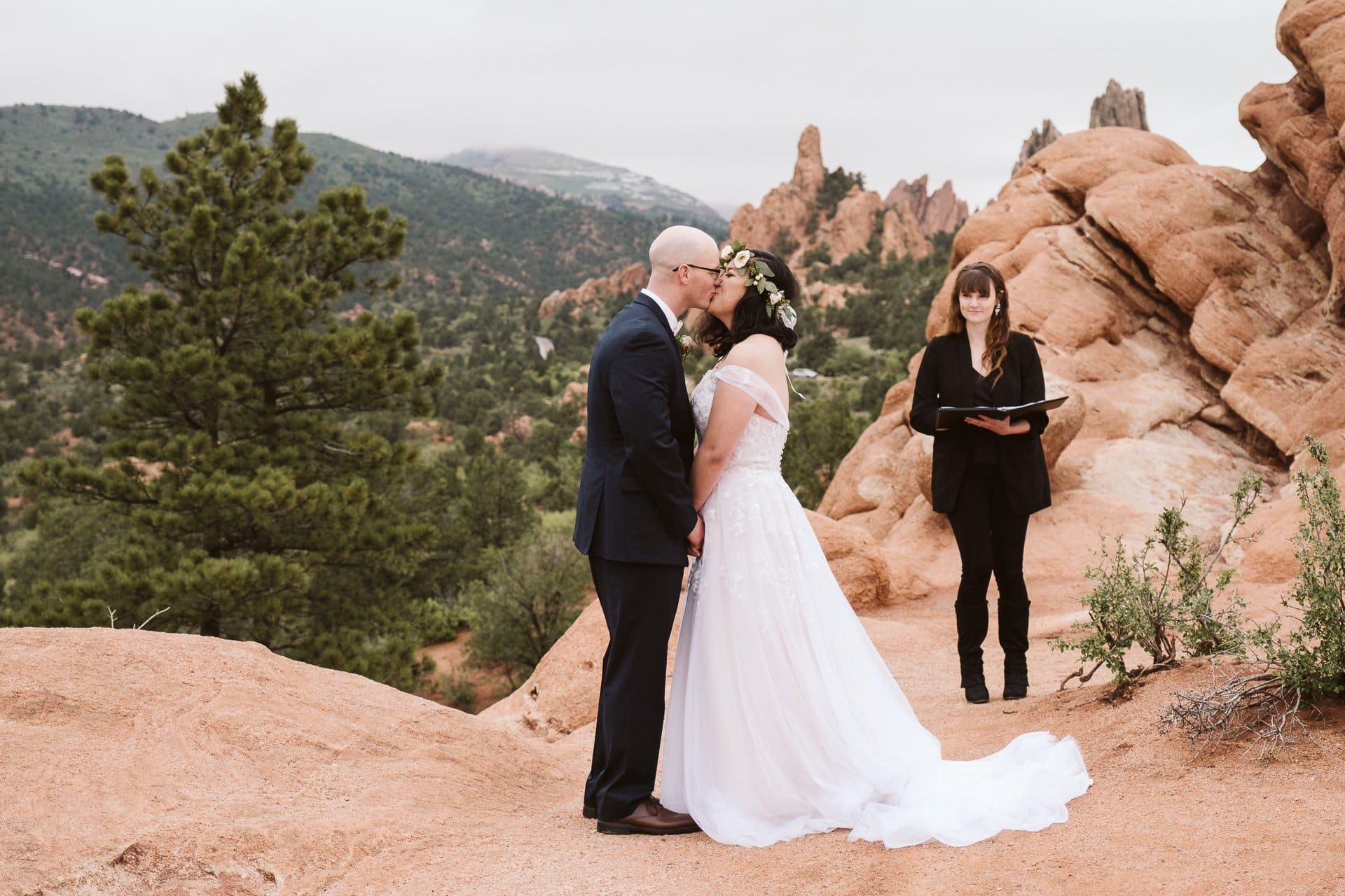 Bride and groom first kiss at their adventure elopement in Colorado Springs