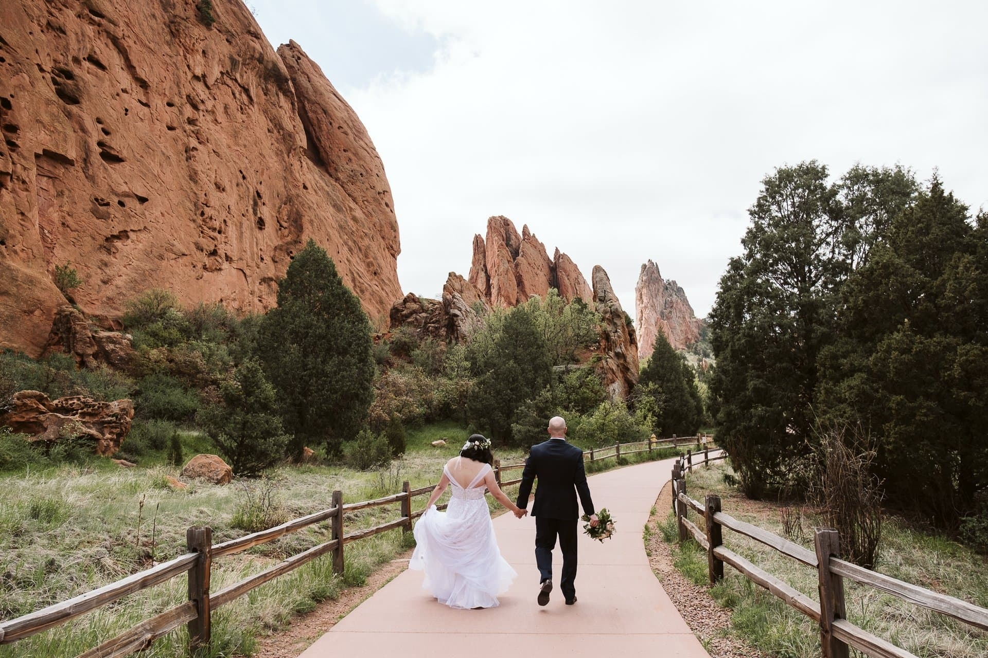 Bride and groom hiking along the trails of Garden of the Gods in Colorado Springs, Colorado elopement photographer
