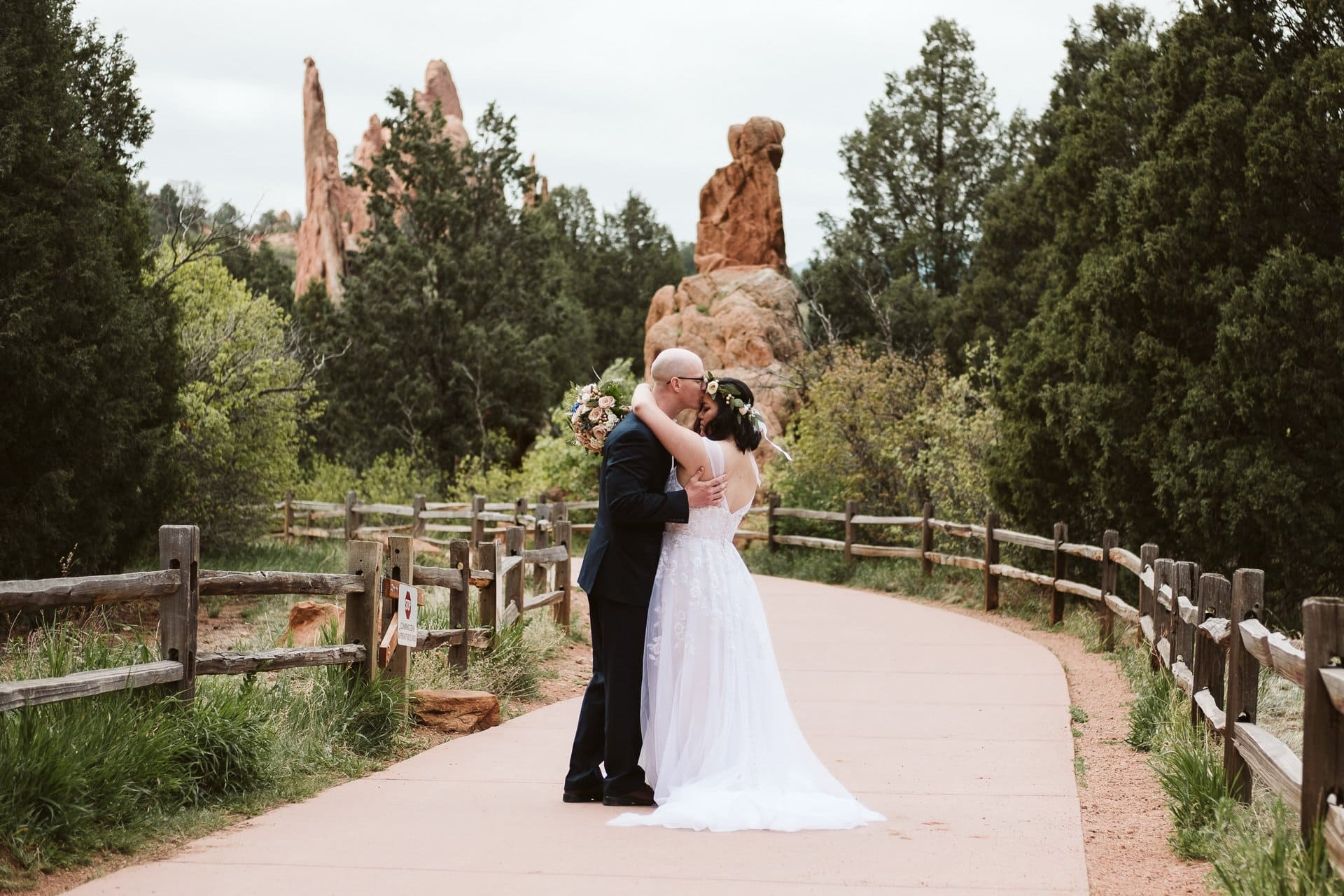 Bride and groom wedding photos at Garden of the Gods in Colorado with jagged red rocks