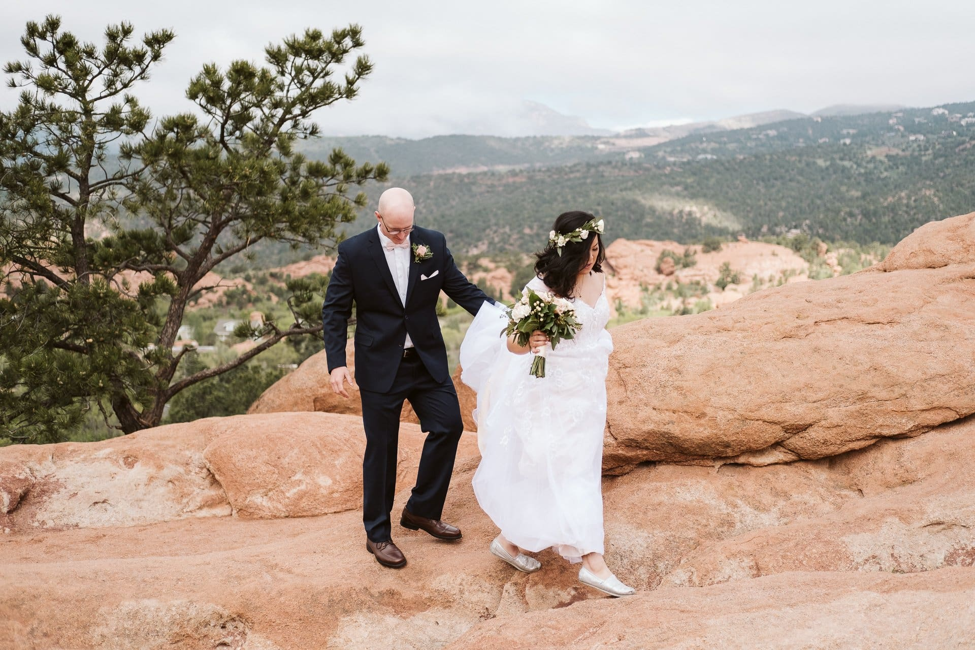 Bride and groom hiking at Garden of the Gods for their adventurous elopement in Colorado Springs