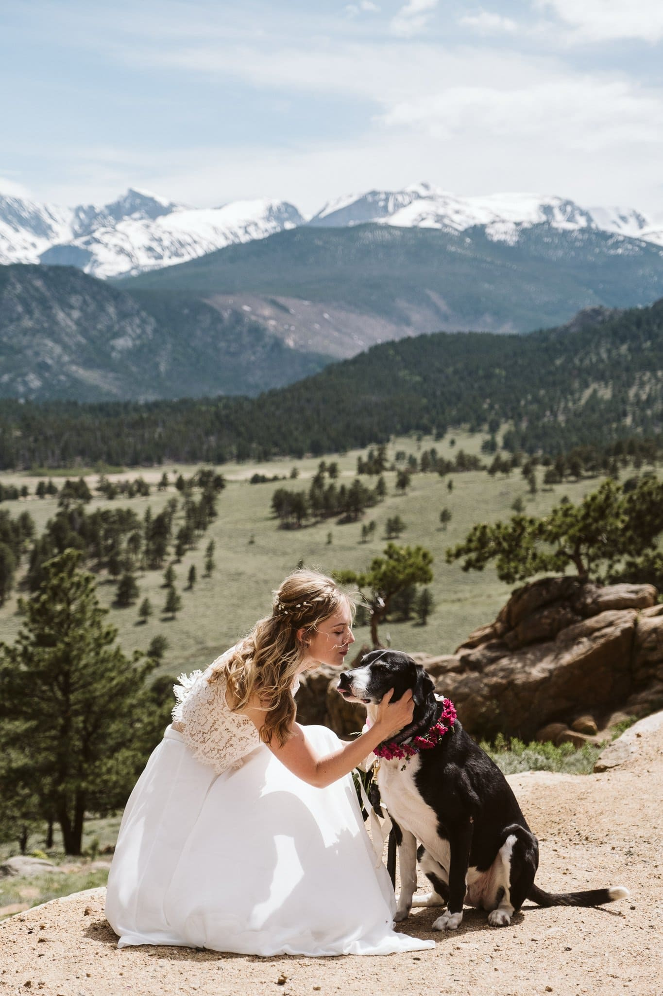 Bride kissing her dog at mountain elopement in Rocky Mountain National Park
