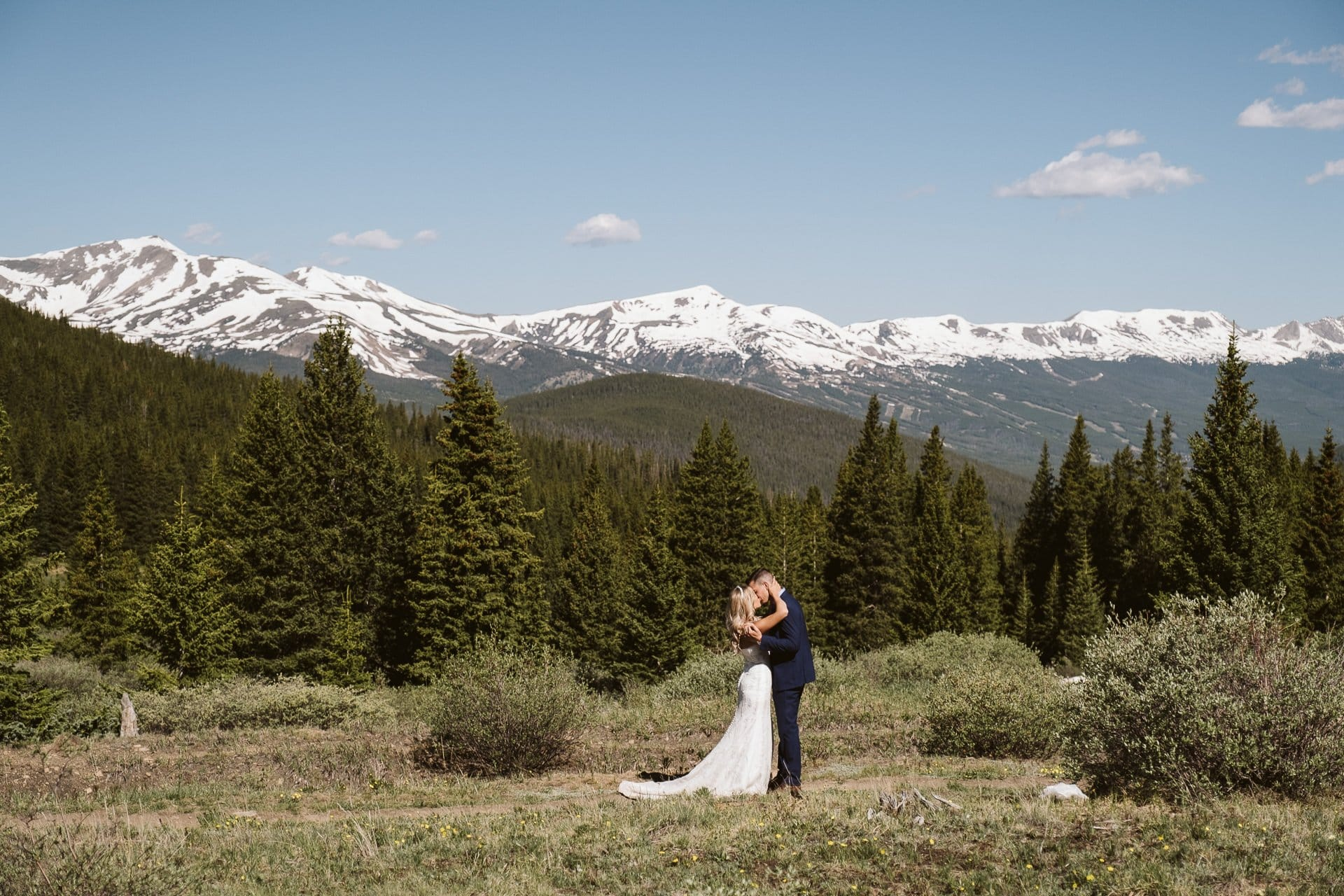 Bride and groom kissing in the mountains of Breckenridge.
