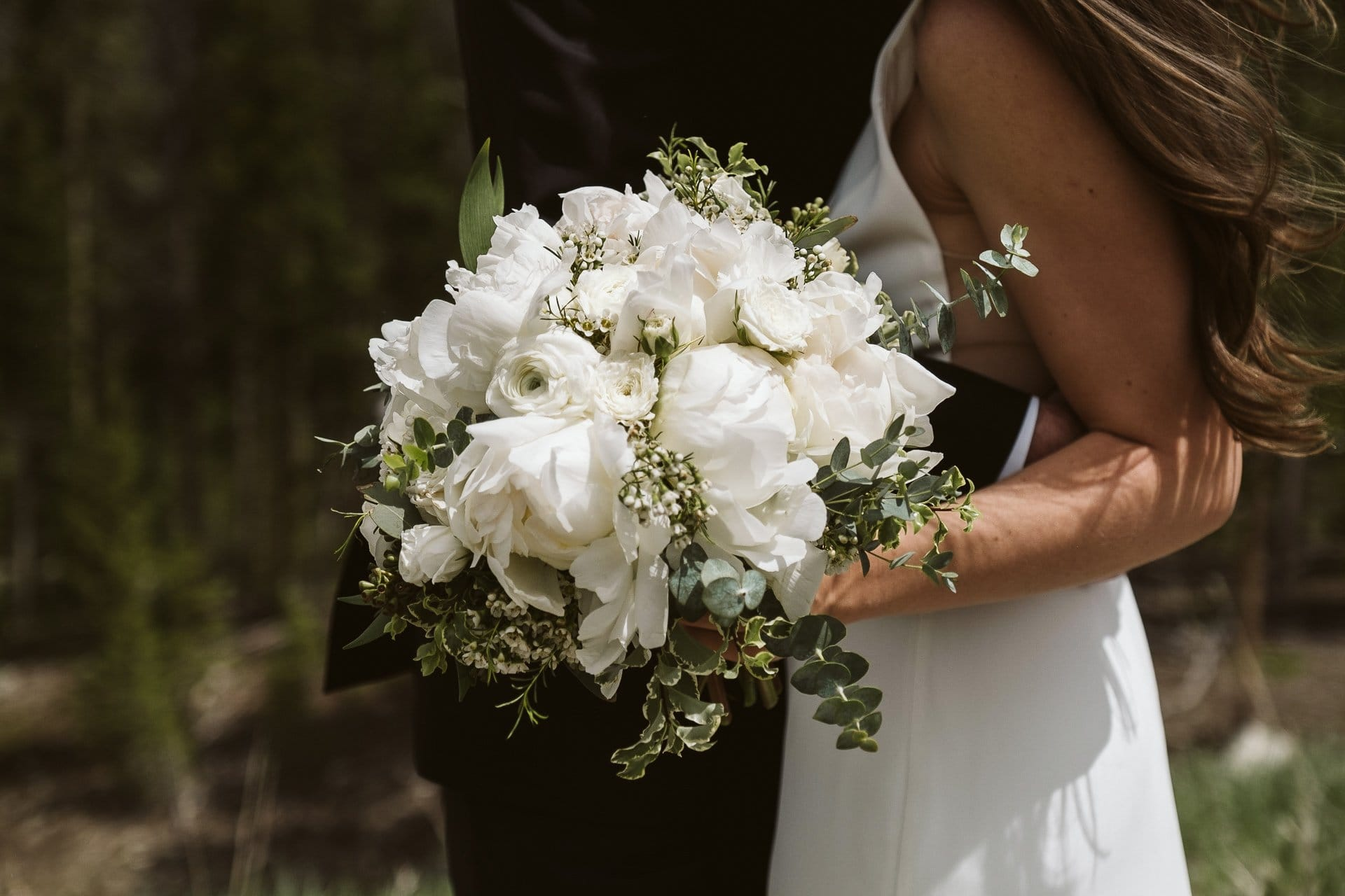 Wedding bouquet with white flowers and greenery by Petal and Bean in Breckenridge