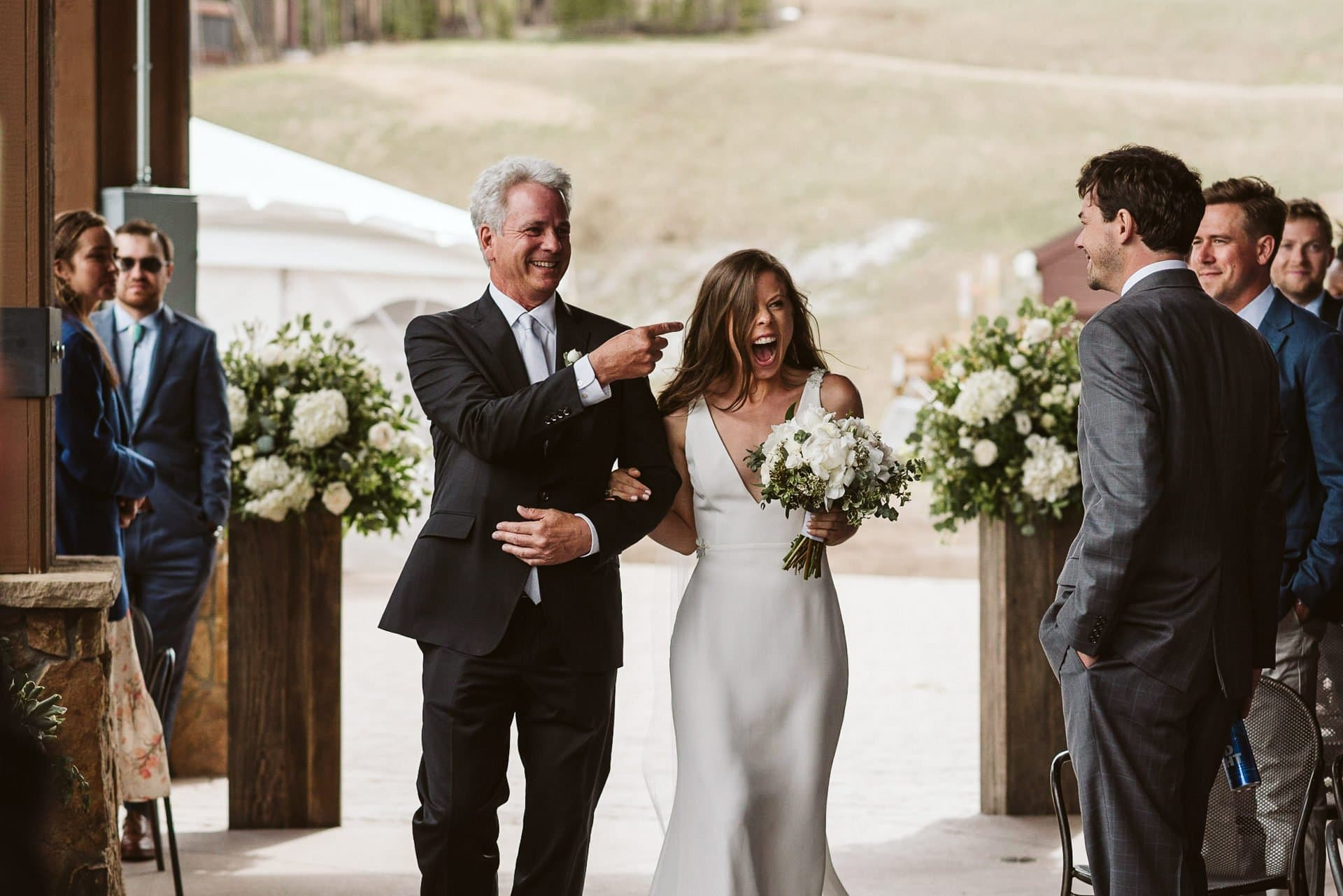 Bride and her father walking down the aisle for wedding ceremony at Breckenridge Ski Resort, Colorado mountain wedding