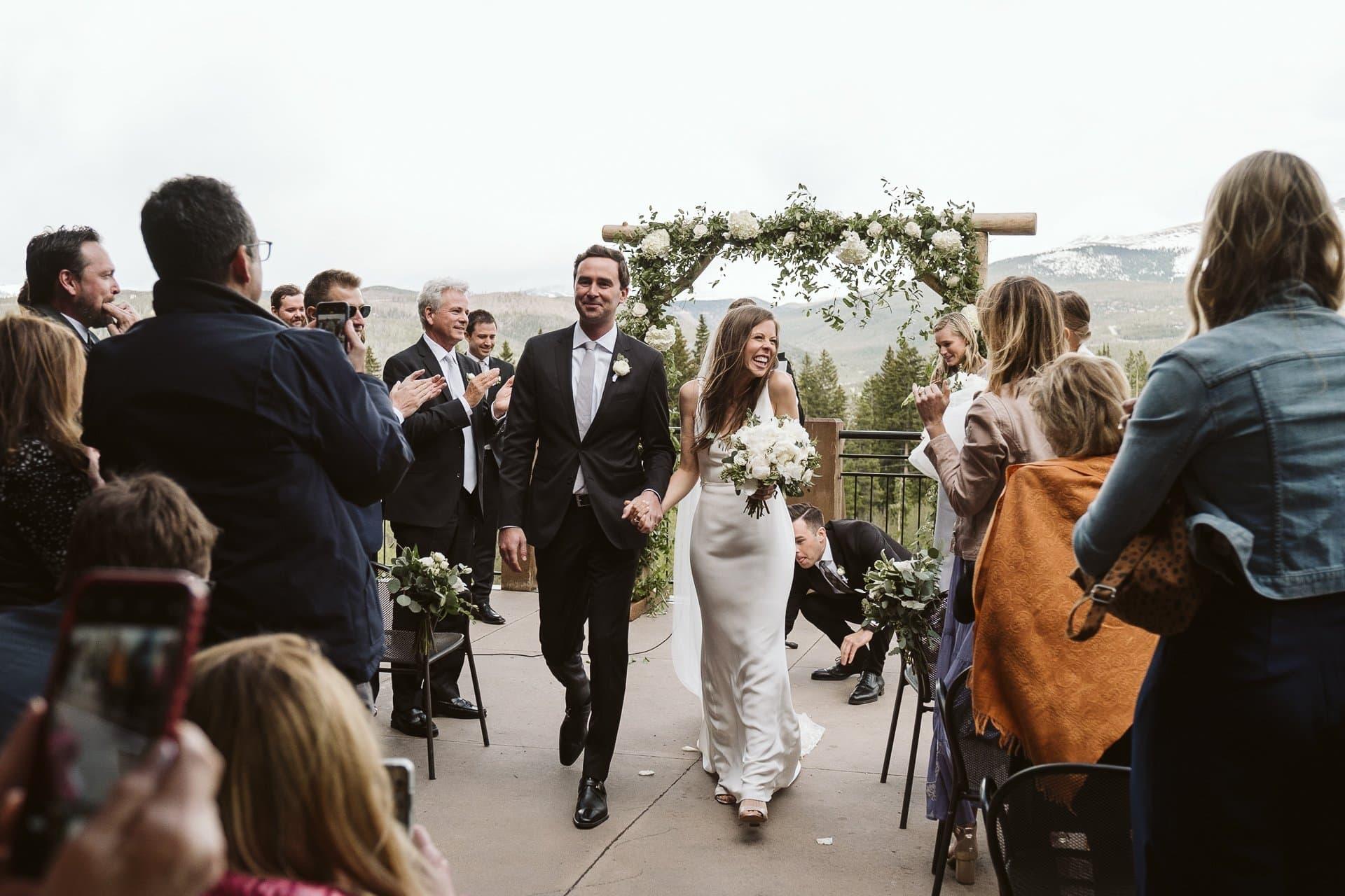 Bride and groom recessional, Wedding ceremony at Sevens at Breckenridge Ski Resort, Colorado mountain wedding photographer