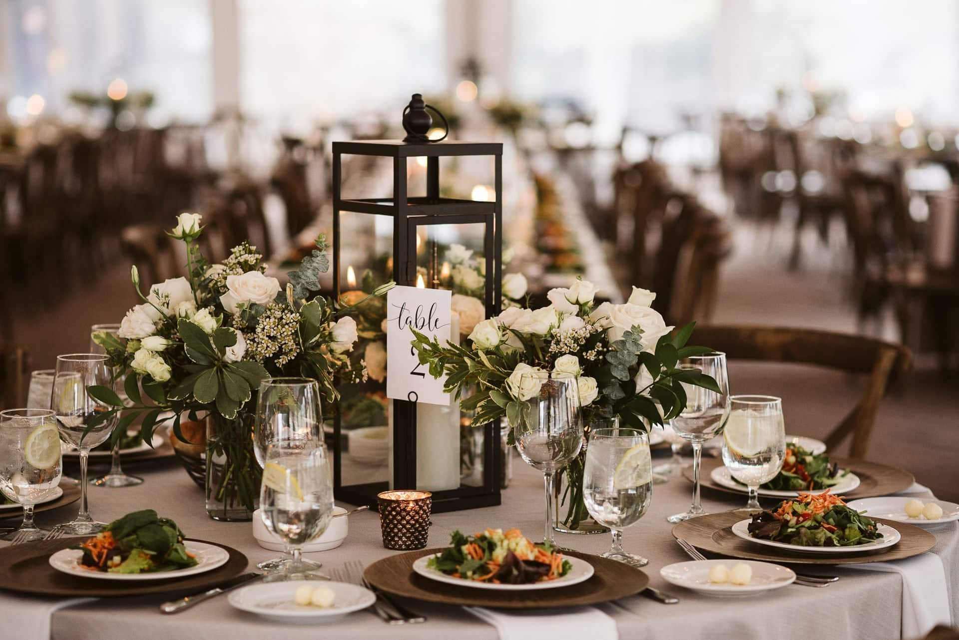White tent wedding reception at Sevens at Breckenridge ski resort, Colorado mountain wedding reception with wood details and white flowers