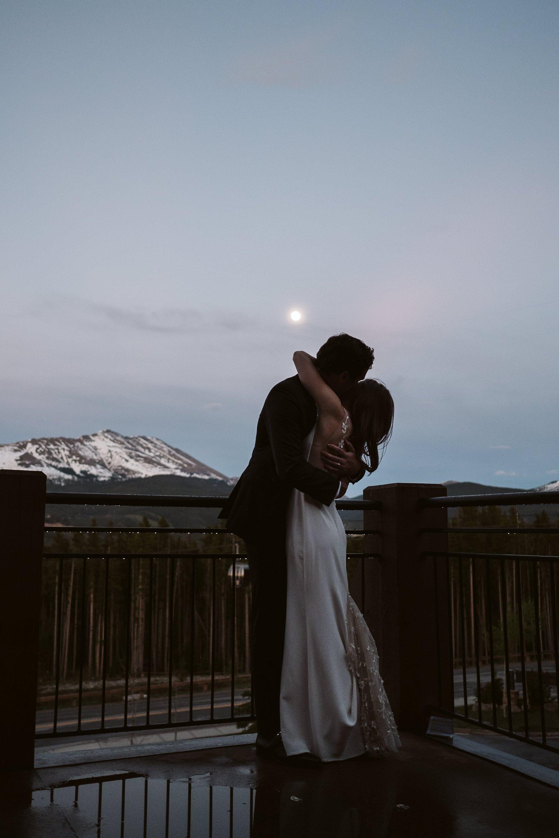 Bride and groom hugging under the moon at Breckenridge Ski Resort