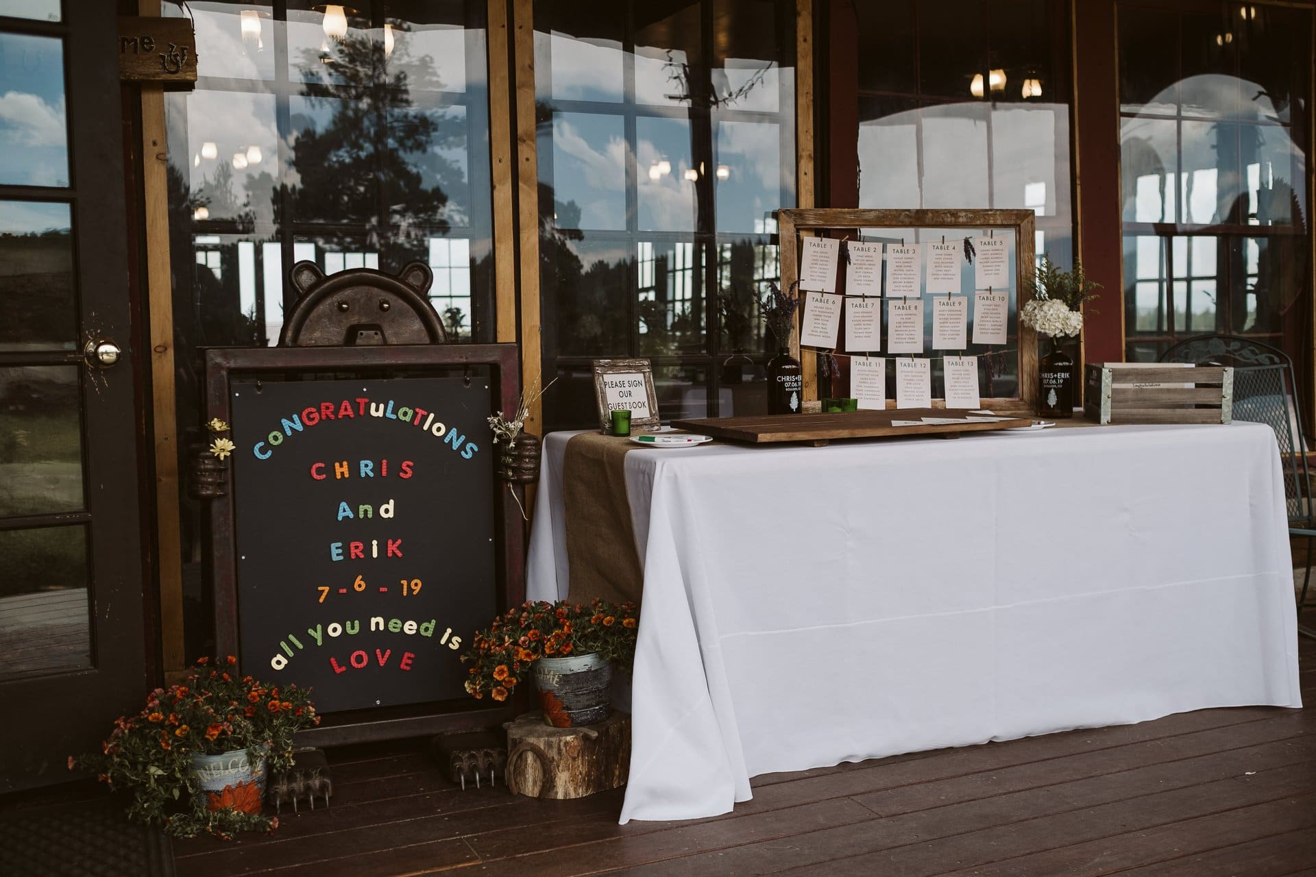 Wedding details and signs at gay wedding at Colorado Mountain Ranch in Boulder