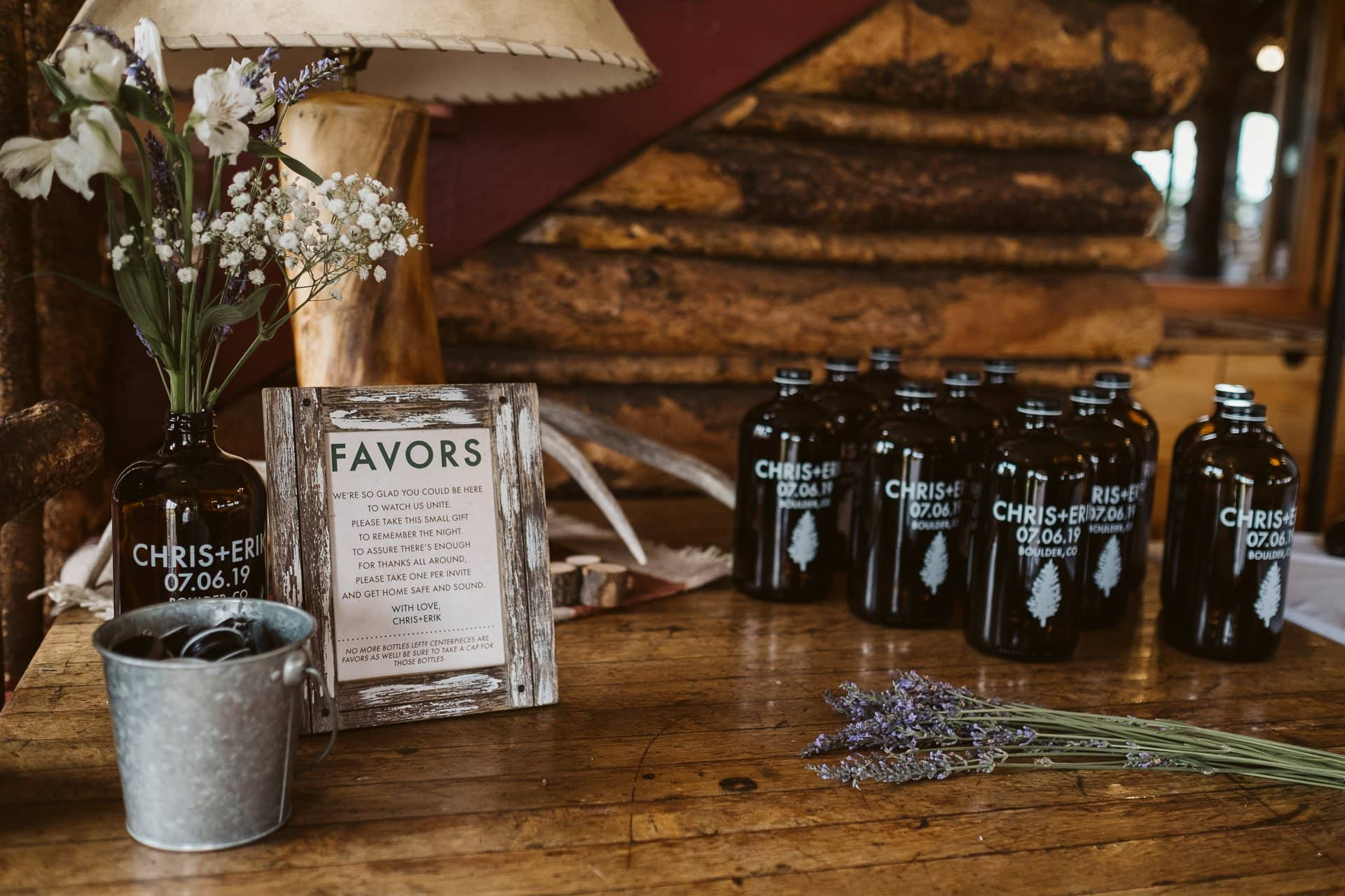 Rustic wood wedding venue at Colorado Mountain Ranch in Boulder, custom printed growlers as wedding favors