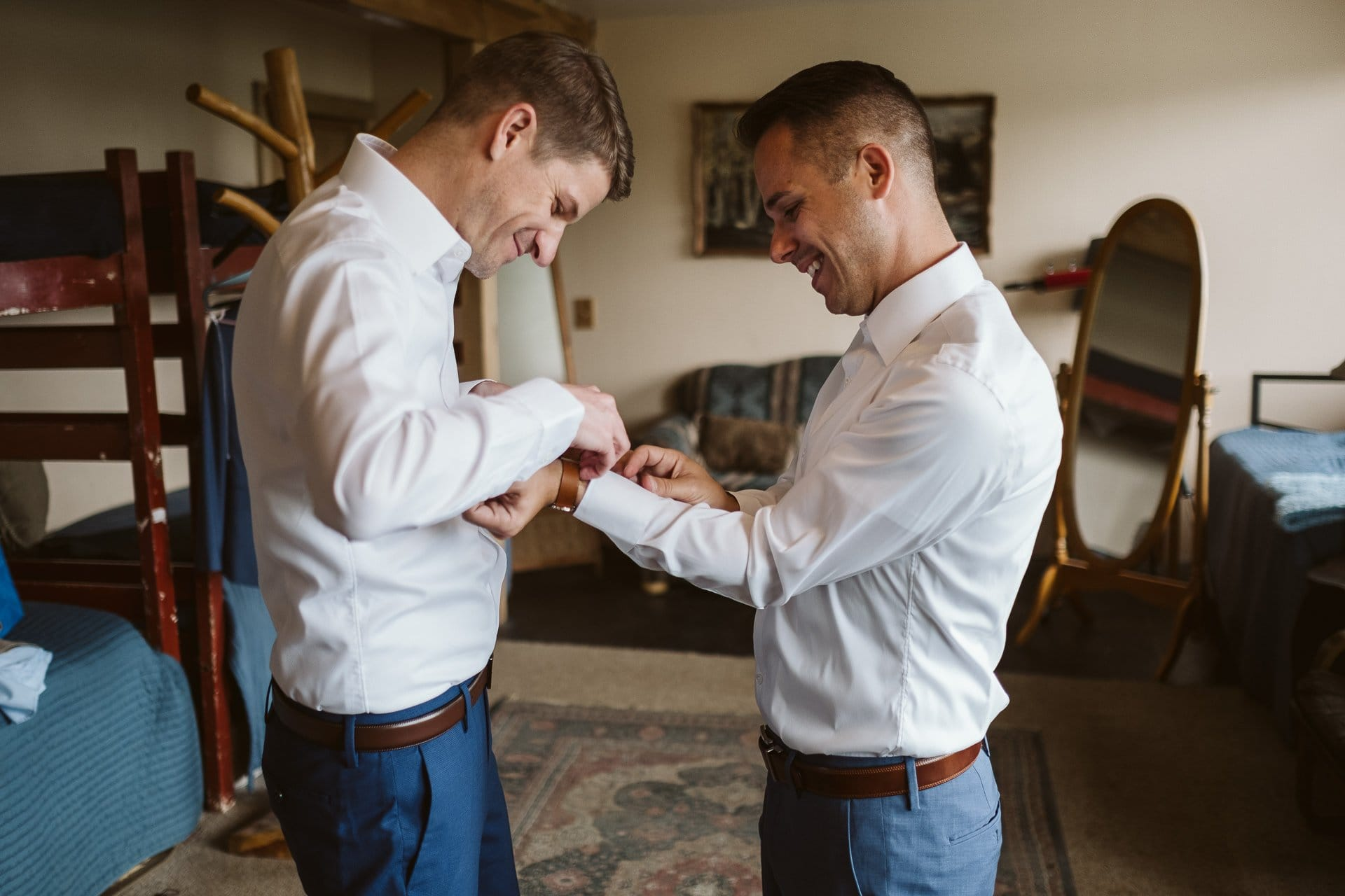 Grooms getting ready together for wedding at Colorado Mountain Ranch