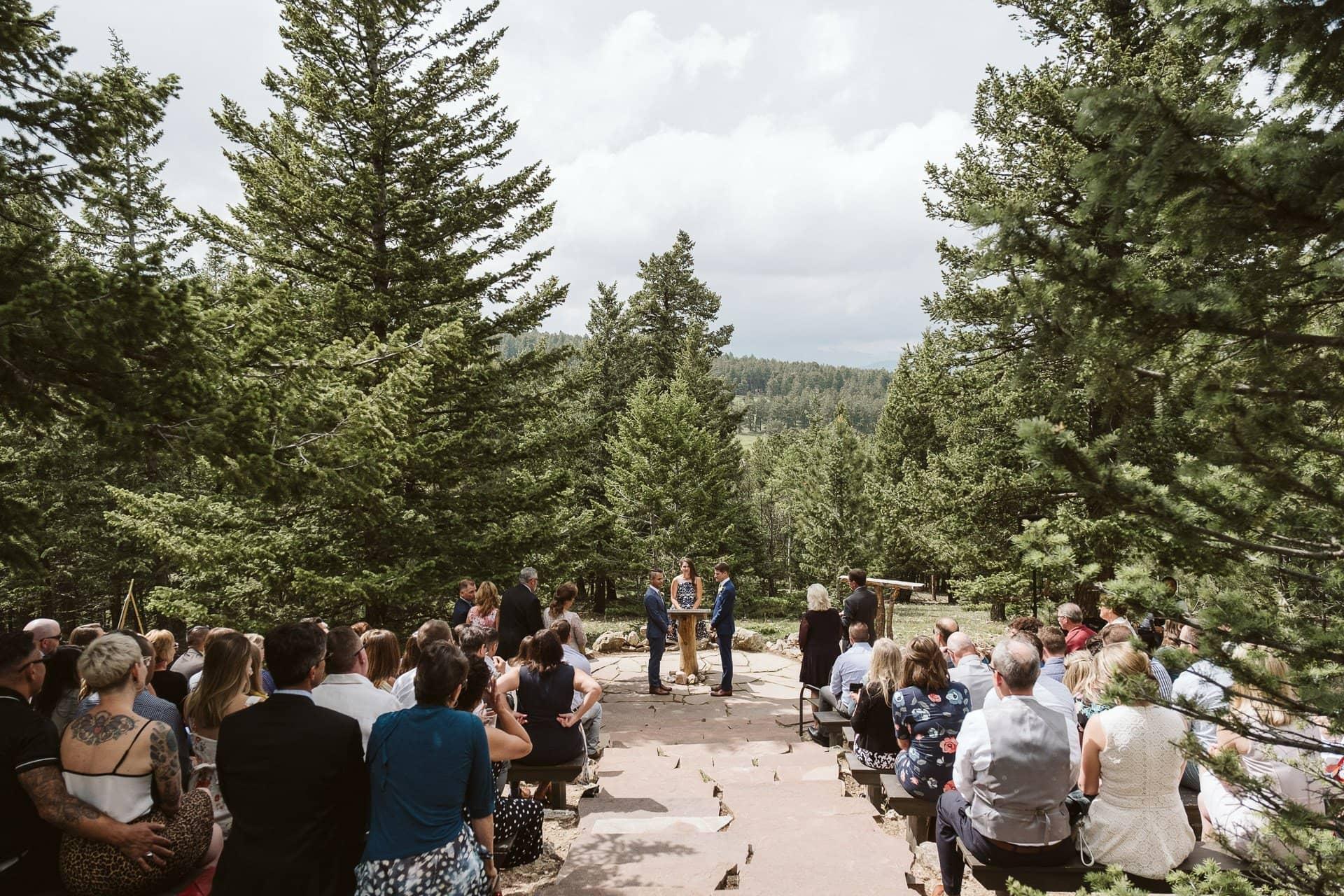 Wedding ceremony at Colorado Mountain Ranch outside Boulder, gay wedding in Colorado