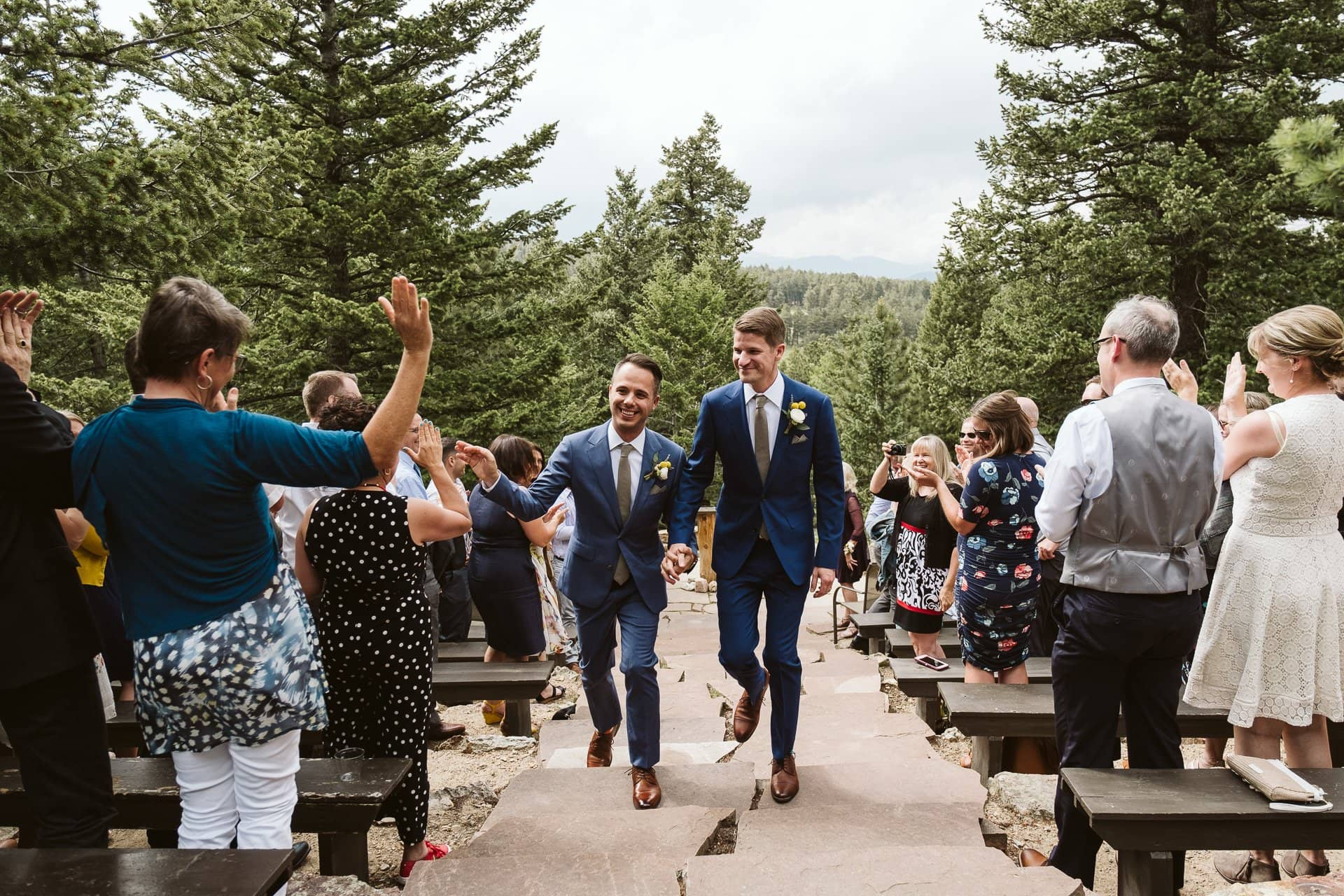 Wedding ceremony at Colorado Mountain Ranch outside Boulder, gay wedding in Colorado