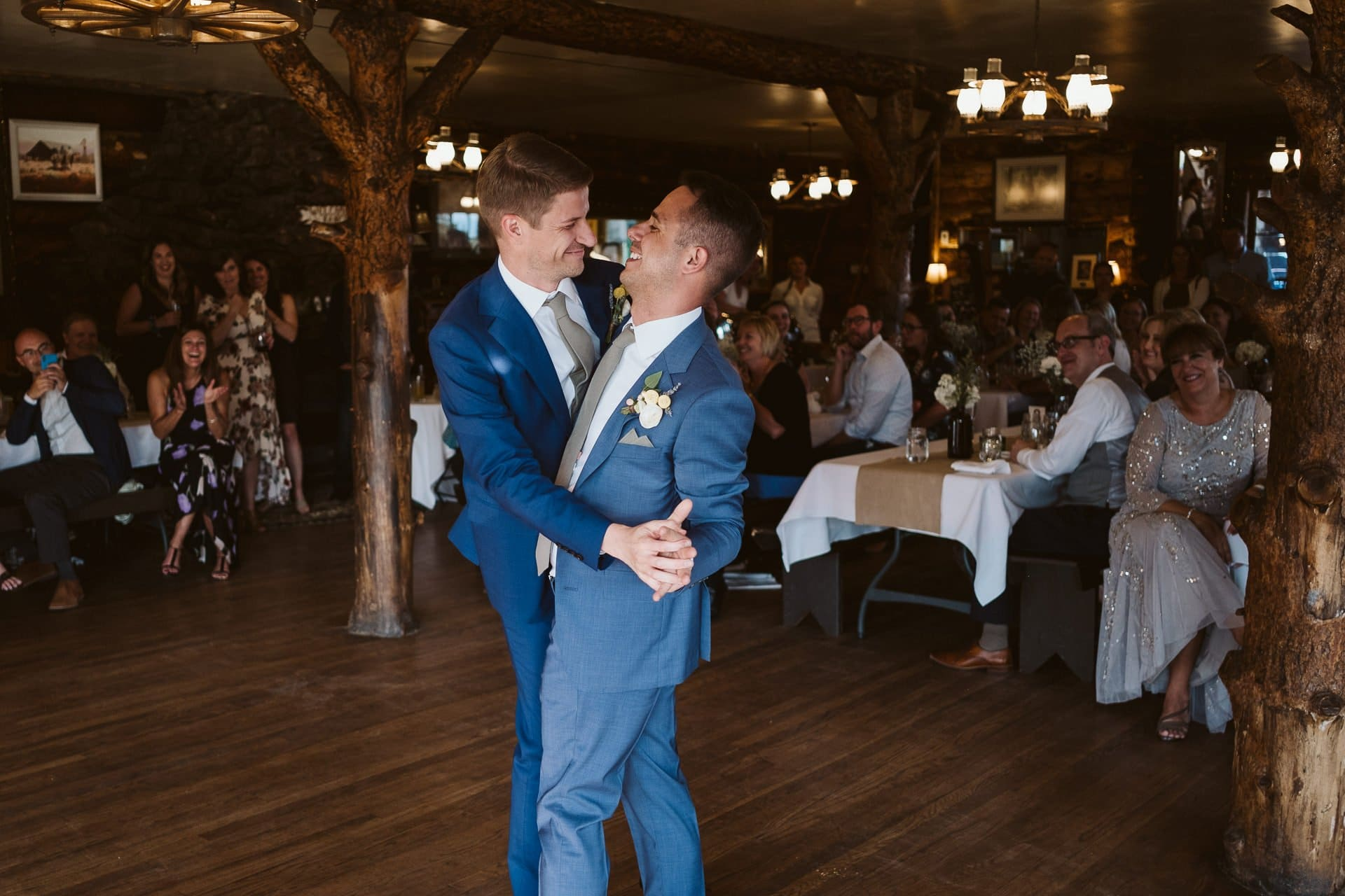 Grooms share first dance at Colorado Mountain Ranch wedding in Boulder