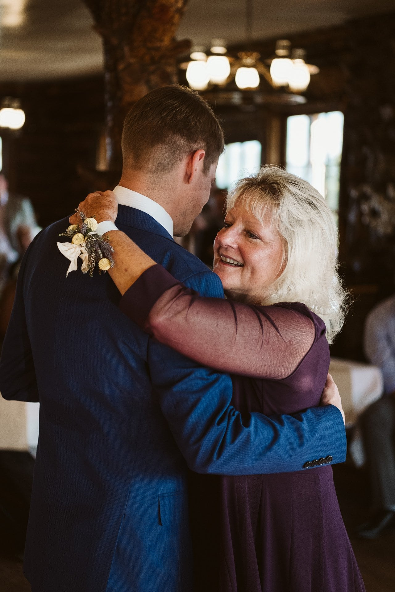 Mother and son dance at wedding at Colorado Mountain Ranch in Boulder