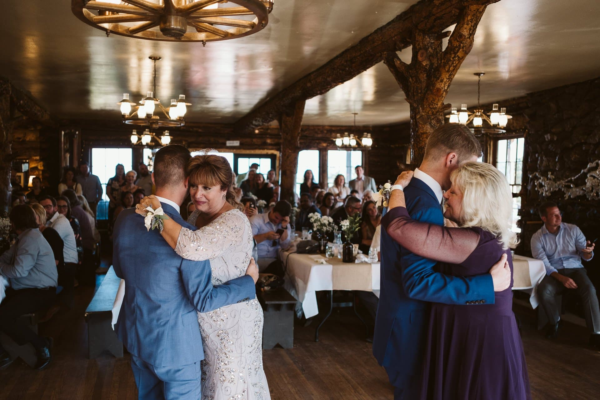 Mothers and sons dance at wedding at Colorado Mountain Ranch in Boulder