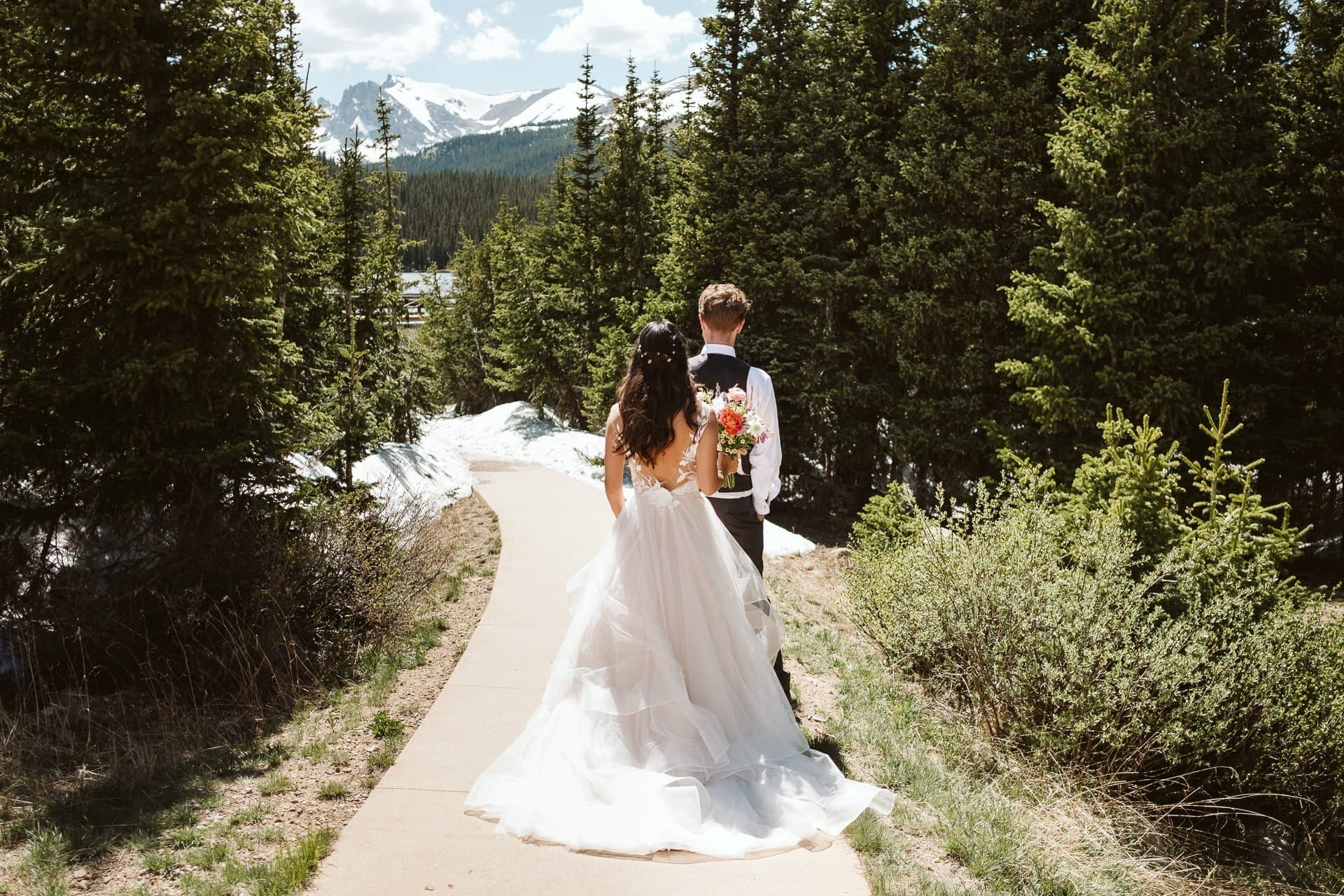 Bride and groom first look in the woods at Brainard Lake outside of Boulder, Colorado hiking elopement photographer