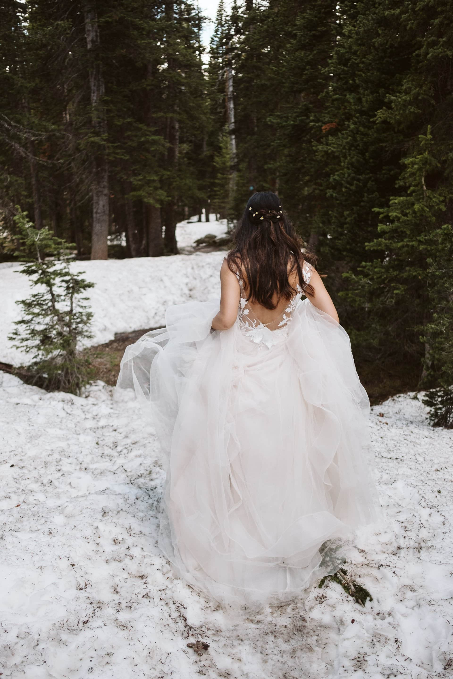 Bride and groom hiking in the Colorado mountains, Indian Peaks Wilderness adventure elopement, Colorado elopement photographer