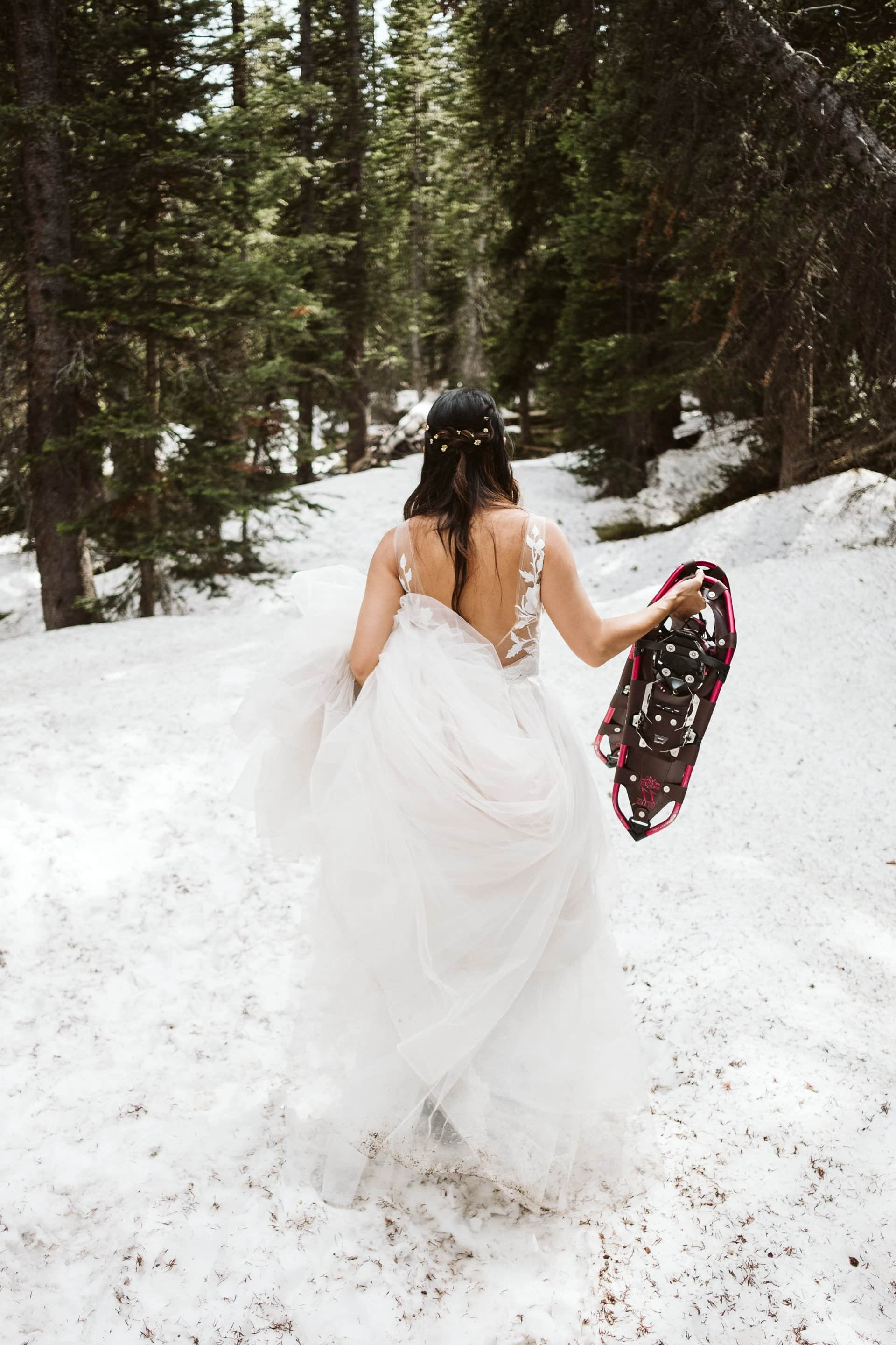 Bride hiking in the Colorado mountains, Indian Peaks Wilderness adventure elopement, Colorado elopement photographer